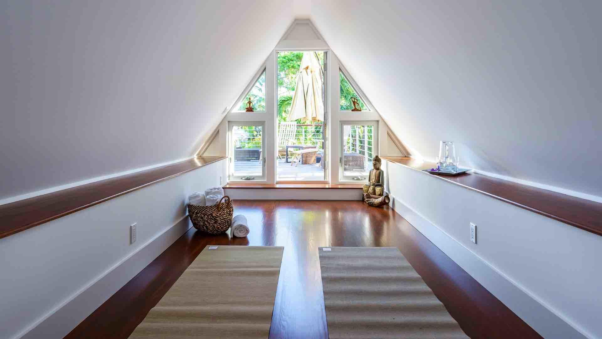 Inside the second Polynesian-style curved roof room is a private yoga studio...