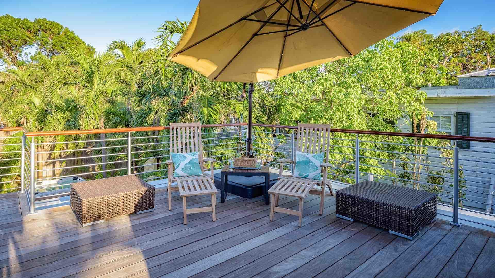 The rooftop deck has chaise lounges and an umbrella...