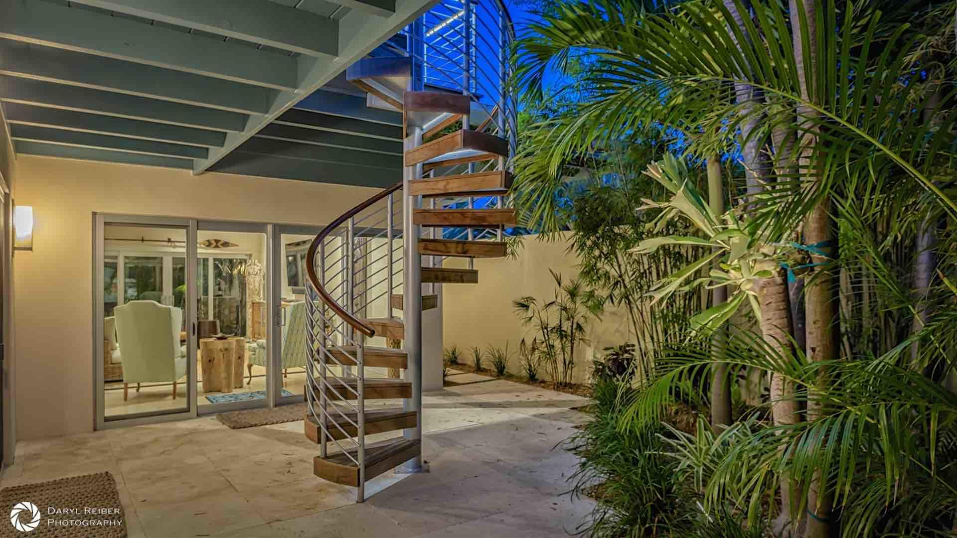 The spiral staircase to the fourth floor can be accessed through the living room or the third bedroom...