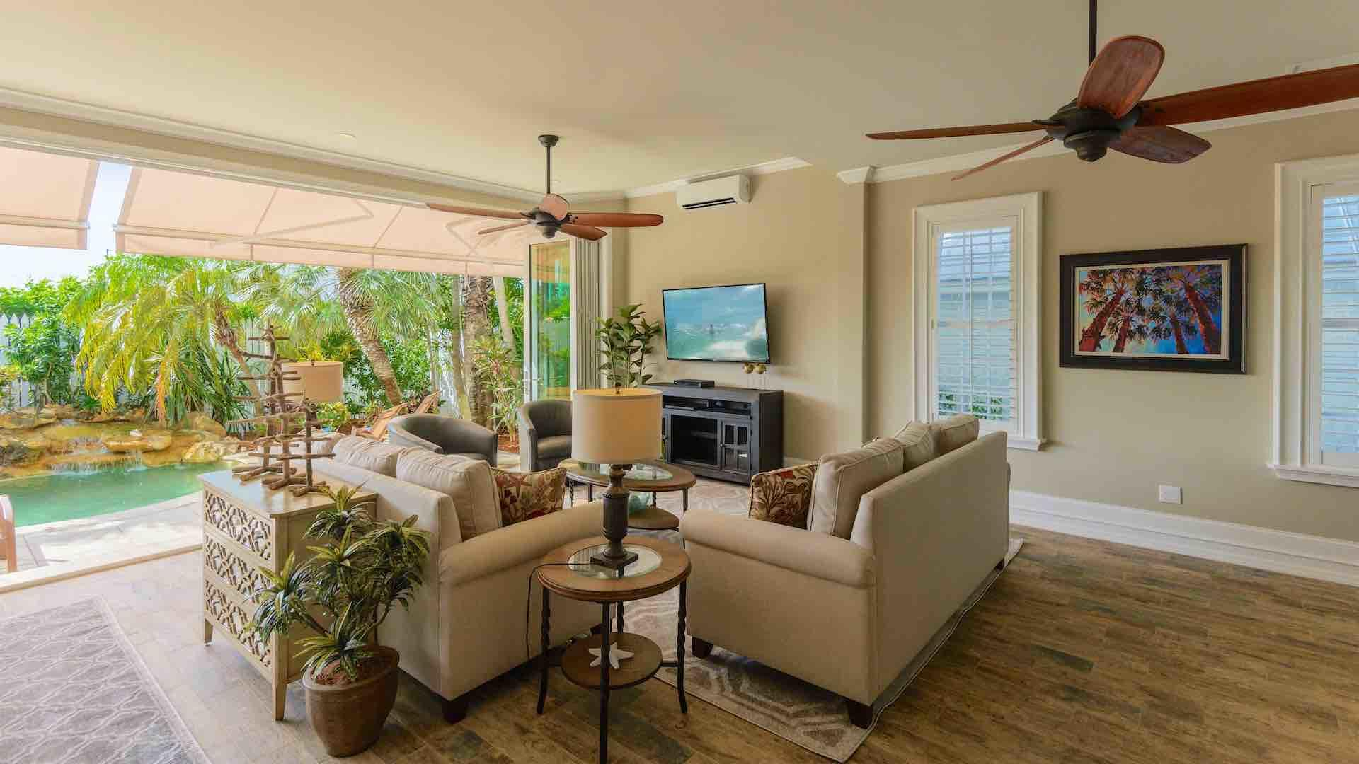 """There is a 60"""" flat screen Smart TV in the living area, and overhead fans..."""