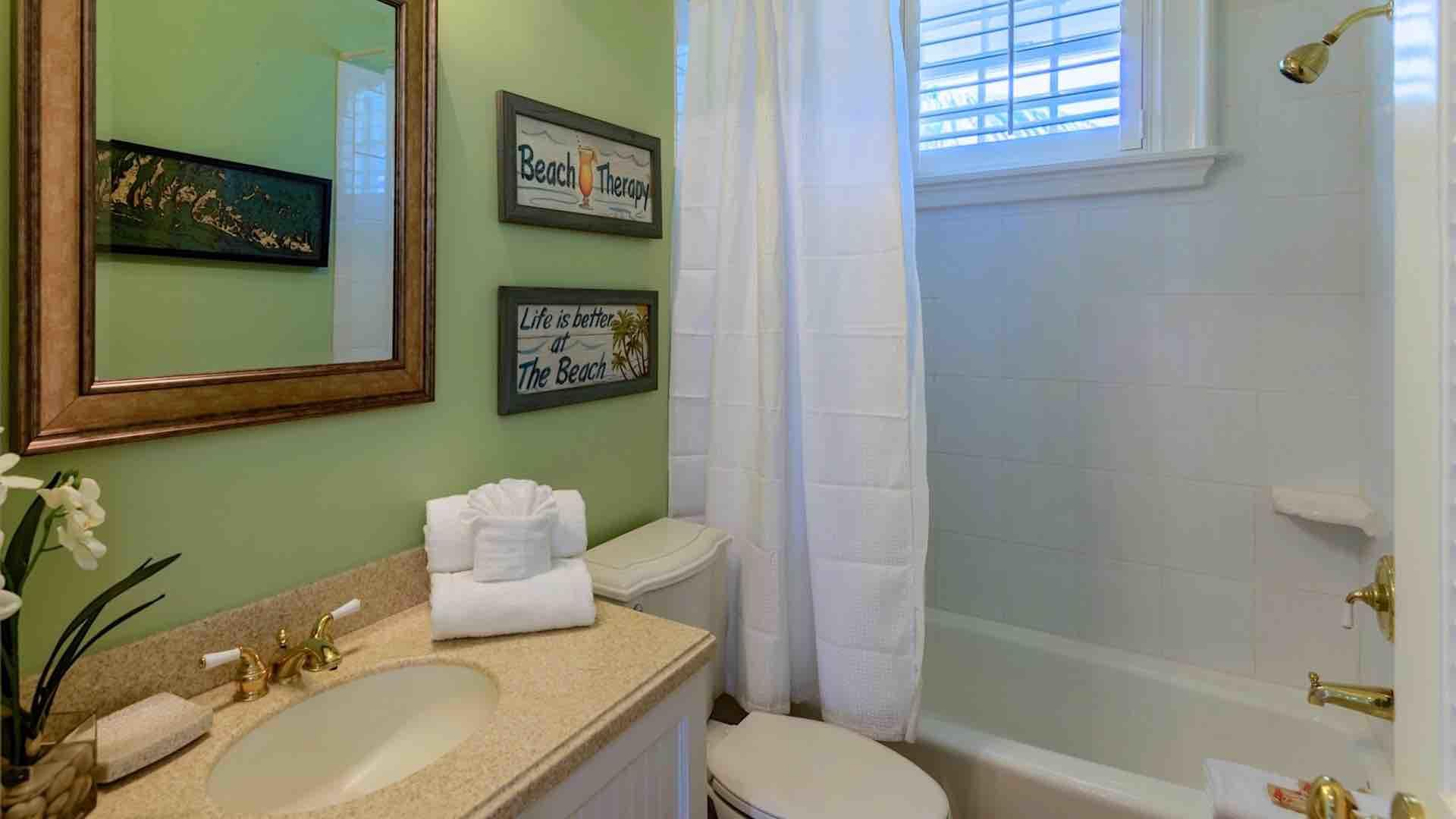 The bathroom with tub and shower is located between the 3rd and 4th bedrooms...