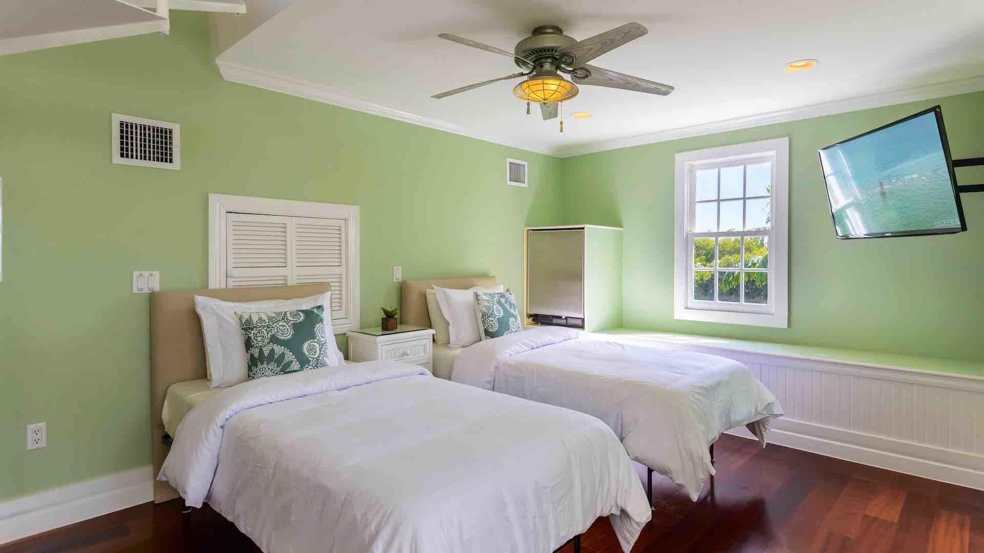 The fifth bedroom is on the 3rd floor, with 2 twin beds that convert to a king..
