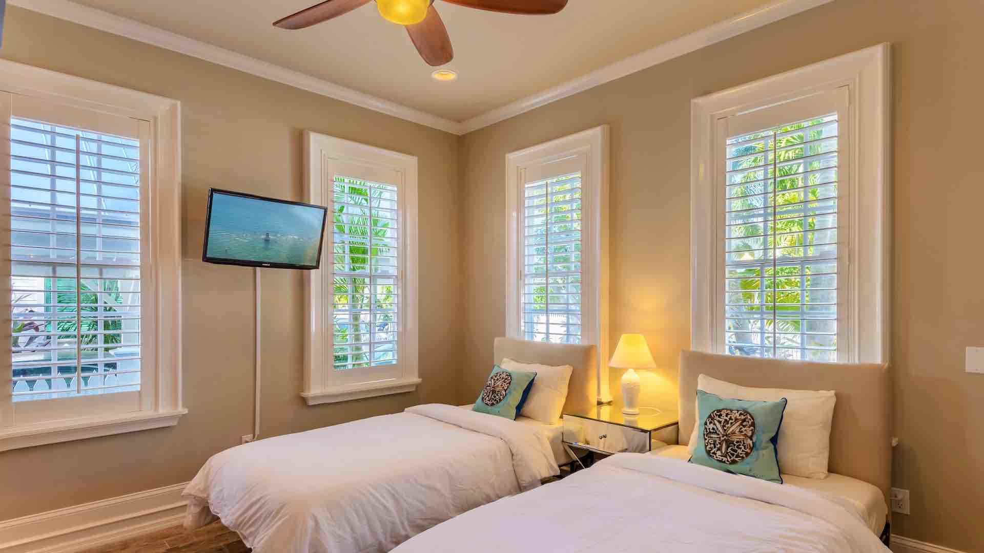 The first bedroom is on the first floor, with flat screen TV and overhead fan...