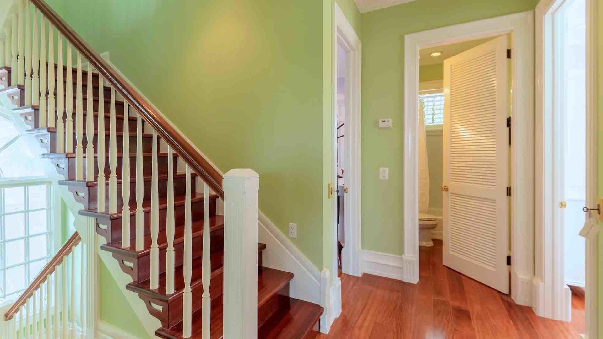 The elegant stairs lead you to the second and third floors of this grand home...