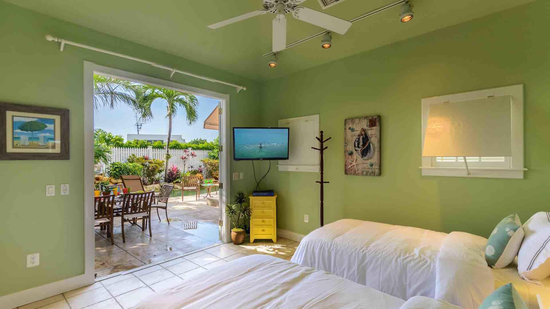The Guest House near the pool has two twin beds that convert to a king...