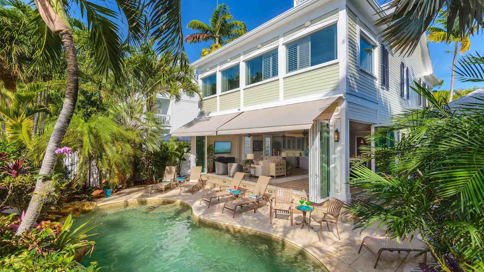 The living room is just a few steps from a lagoon-style pool with waterfalls...