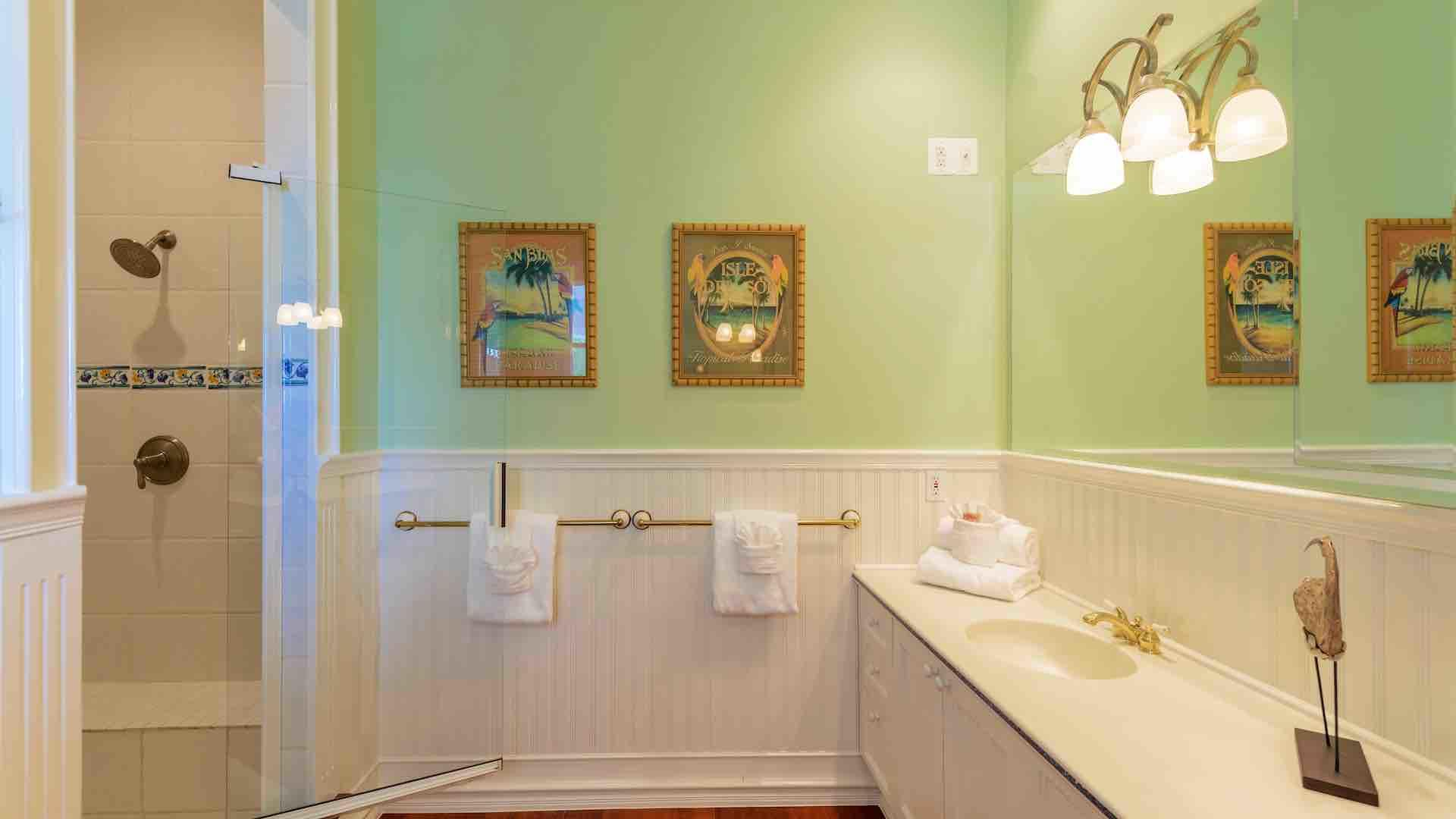 The master bath has a large custom shower with a built in bench..
