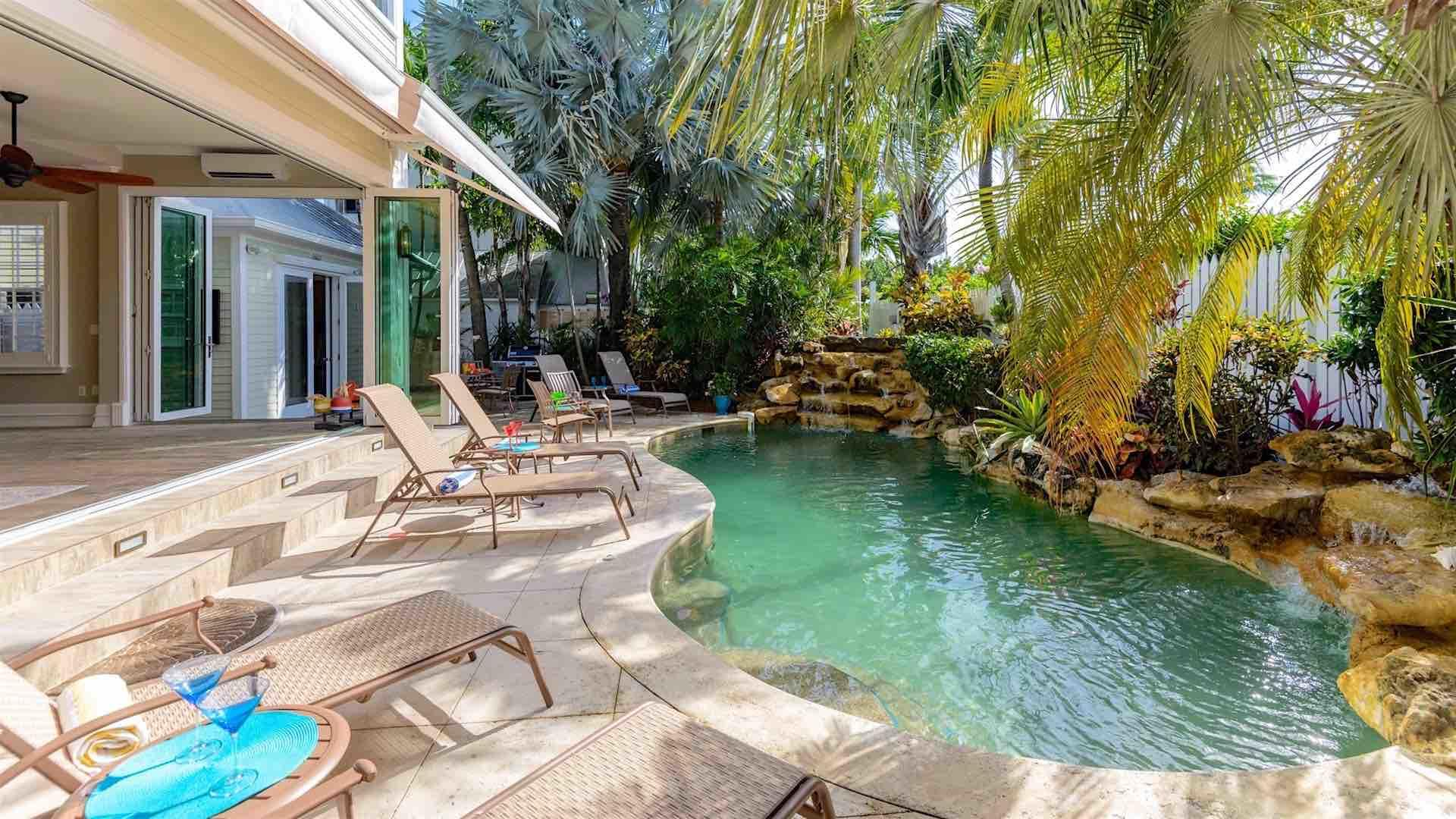 The pool has two waterfalls & built-in seating. There is plenty of seating...