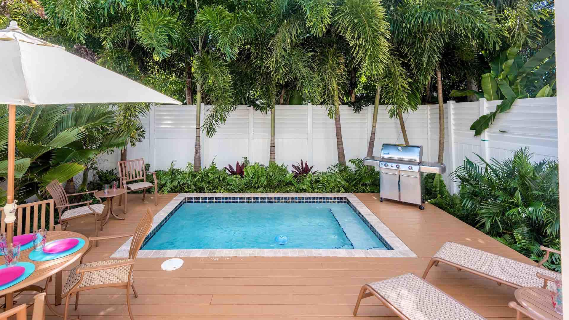 The heated pool and large BBQ grill complete your island retreat...