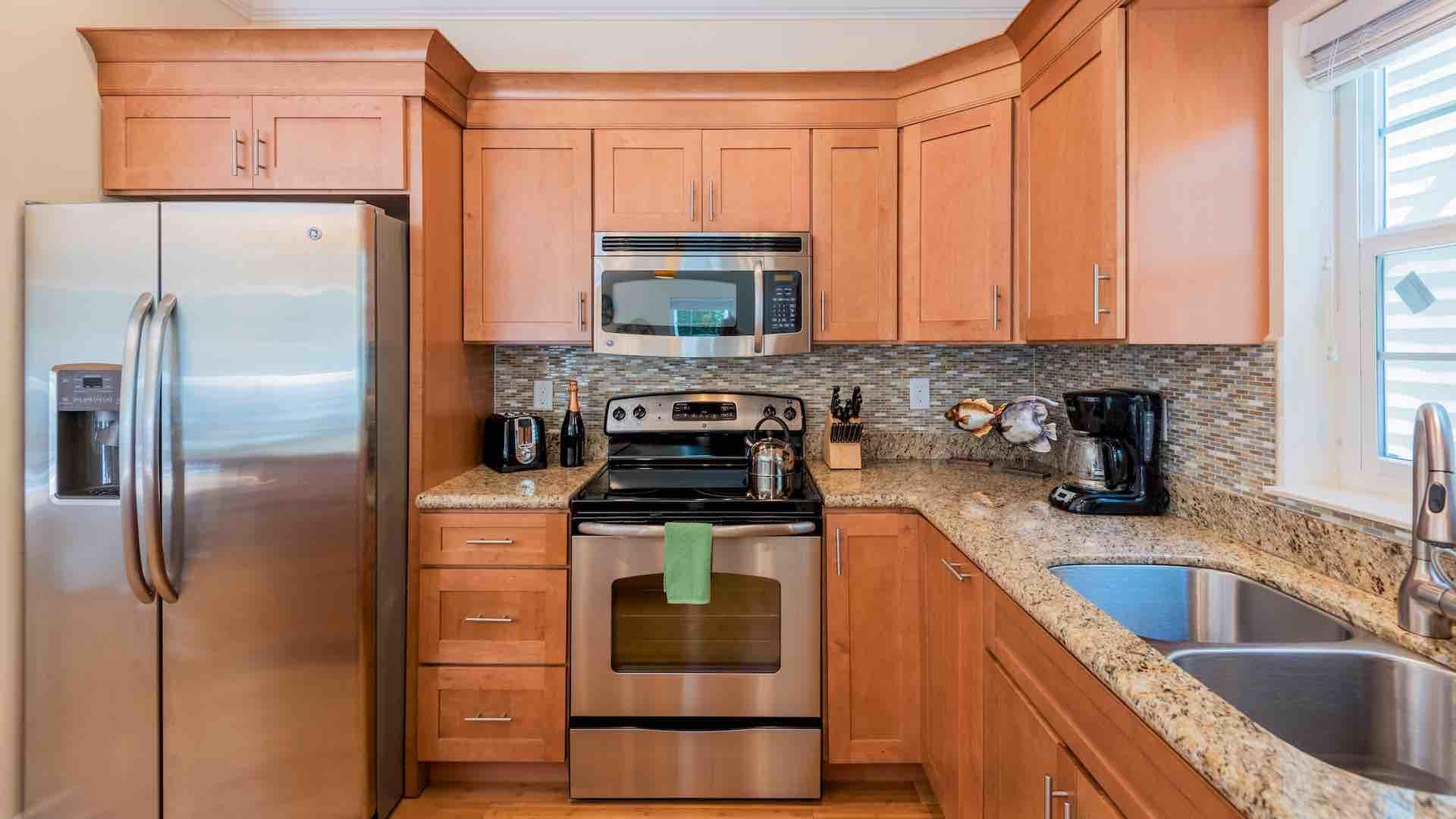 The kitchen has plenty of counter space & comes completely equipped...