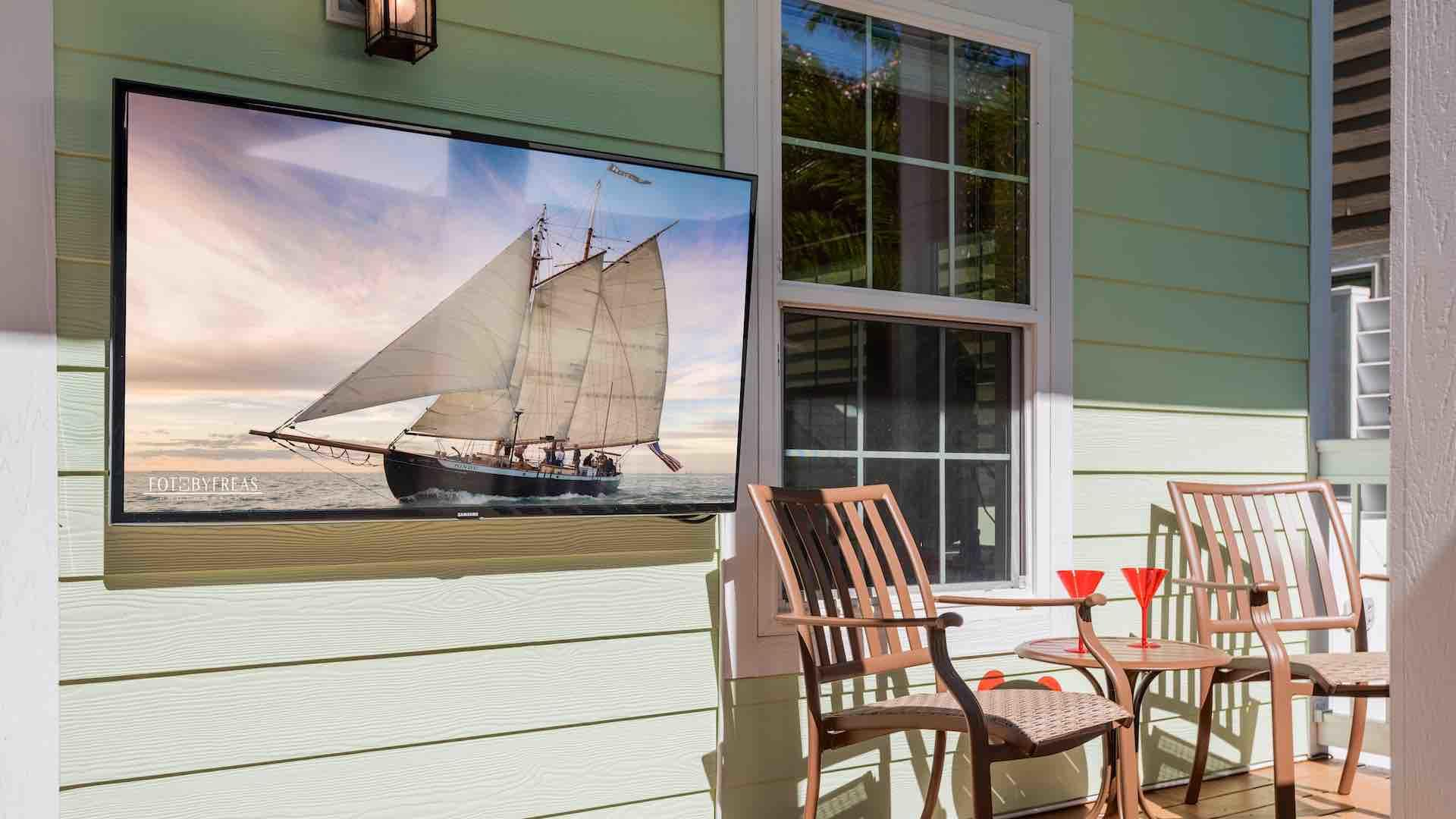 The large flat screen outdoor TV is perfect for this modern island home...