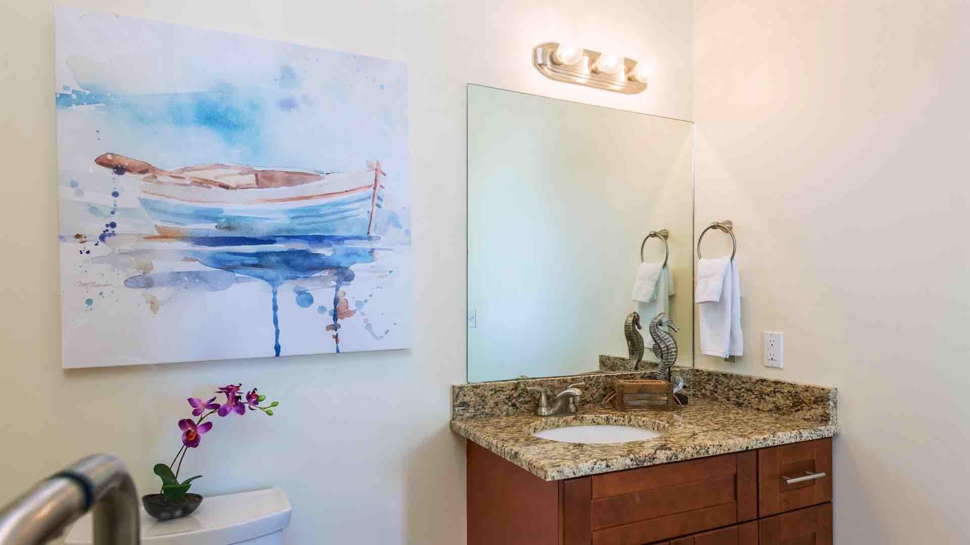 The second bathroom is located in the hallway between the second and third bedrooms...
