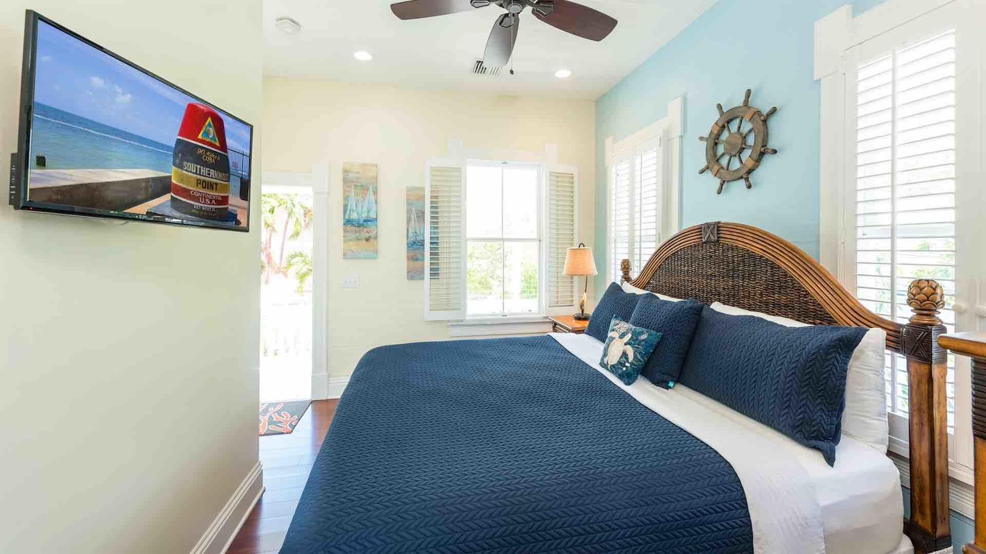 The third bedroom has a King bed, an overhead fan, and a flat screen TV...