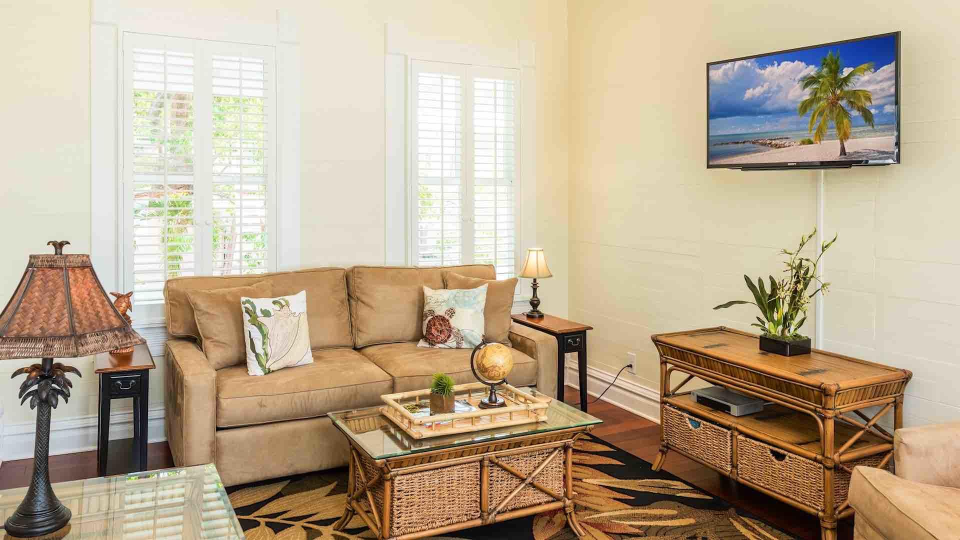 The living room of Villa Angelita has a flat screen TV and comfortable seating options...