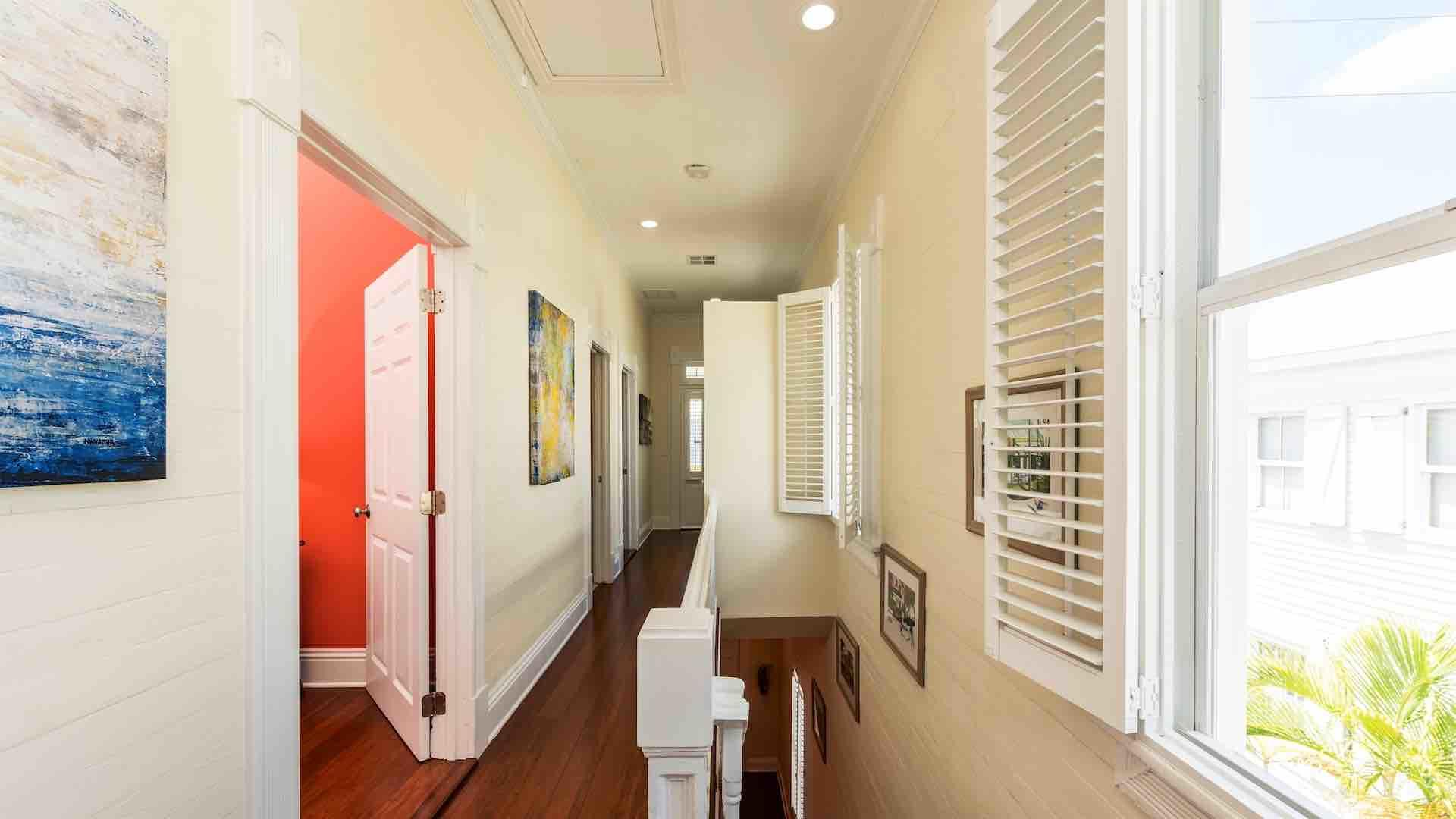 You'll enter the condo through the front door on the first floor and climb the stairs to the second floor...