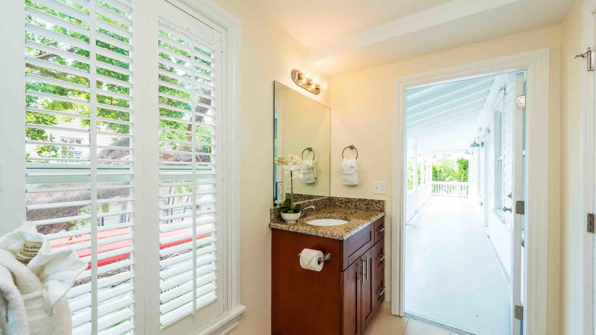 The master bathroom has direct access to the spacious wrap-around balcony...