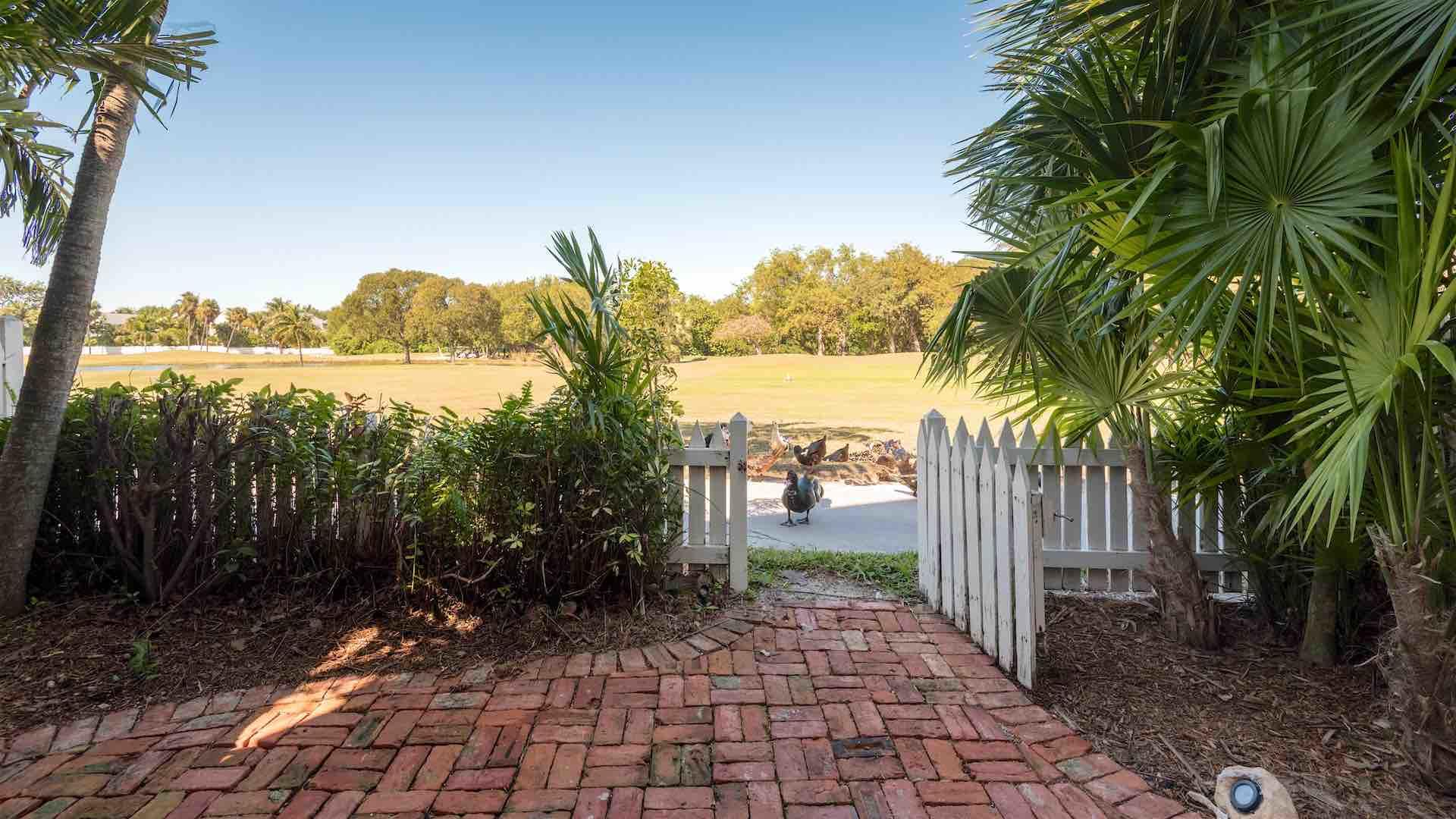 The backyard is completely fenced for privacy and has a gate that leads to the Golf Course...