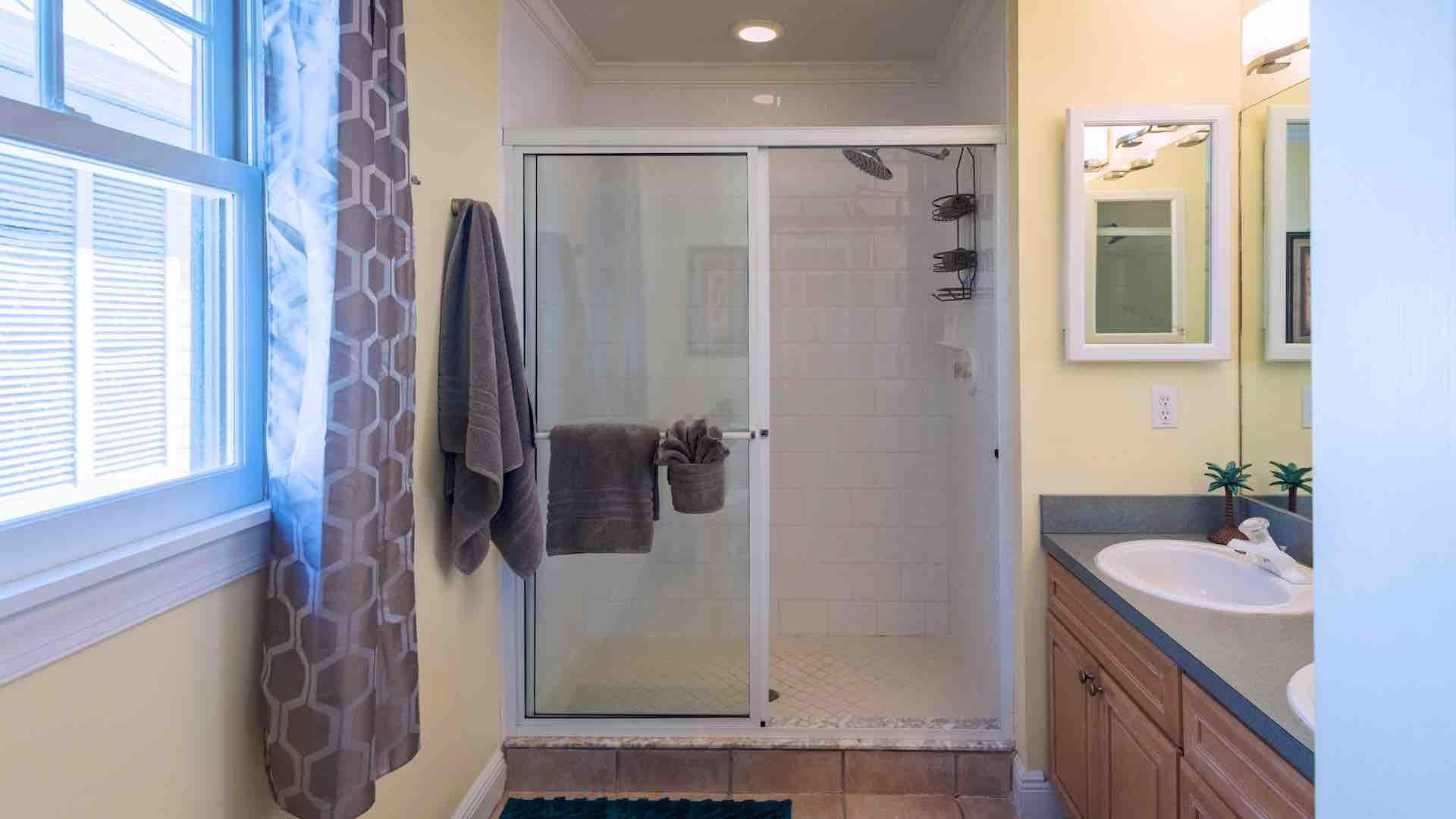 The master bathroom is en suite, with a walk-in shower...