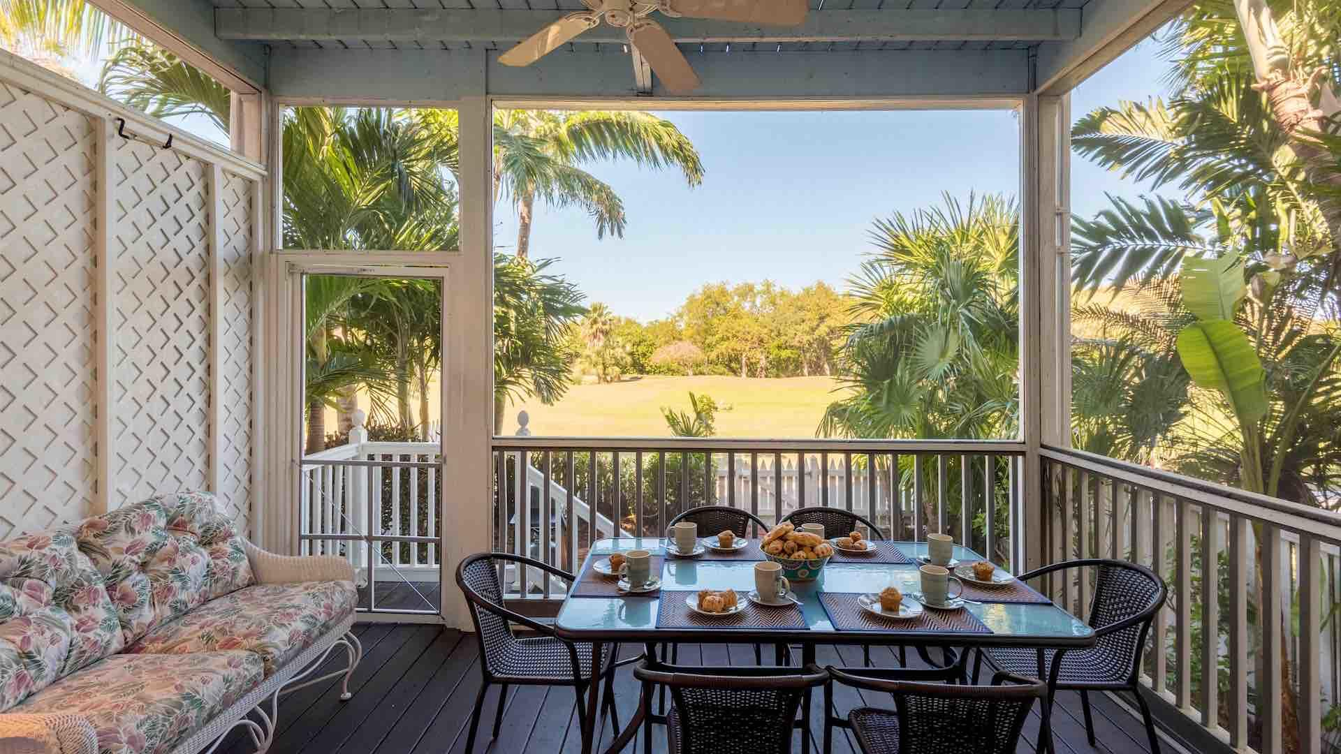 The screened in back patio has an outdoor dining set that seats six...