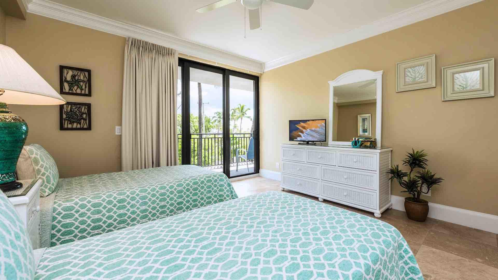 The third bedroom also has a flat screen TV and balcony access...
