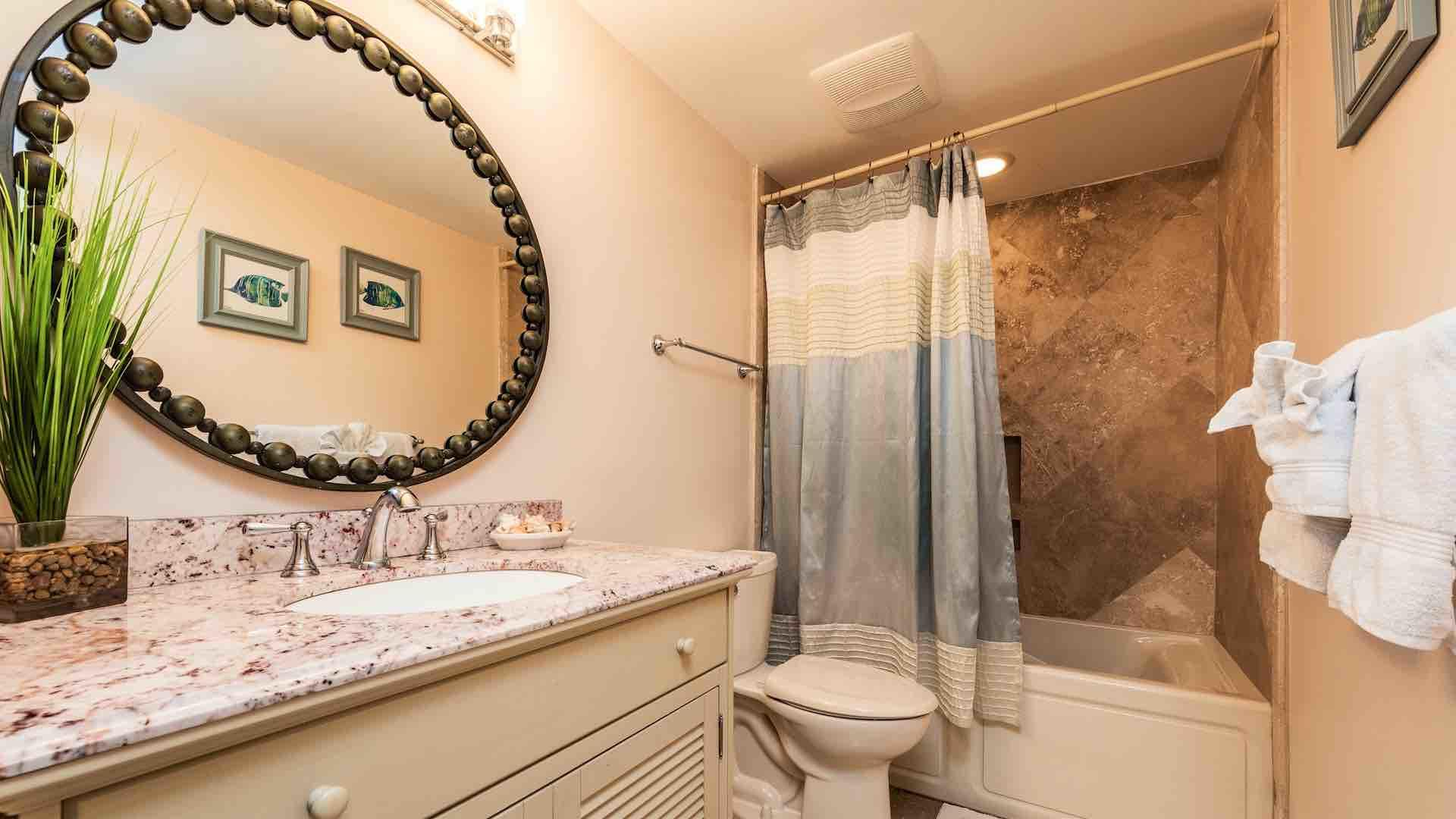 The second full bathroom is located in the hall between the second and third bedrooms...
