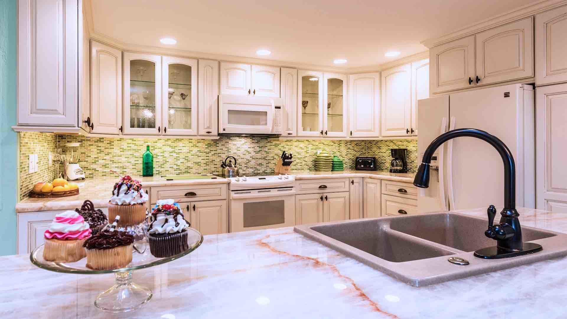 The kitchen has plenty of cabinet and countertop space...