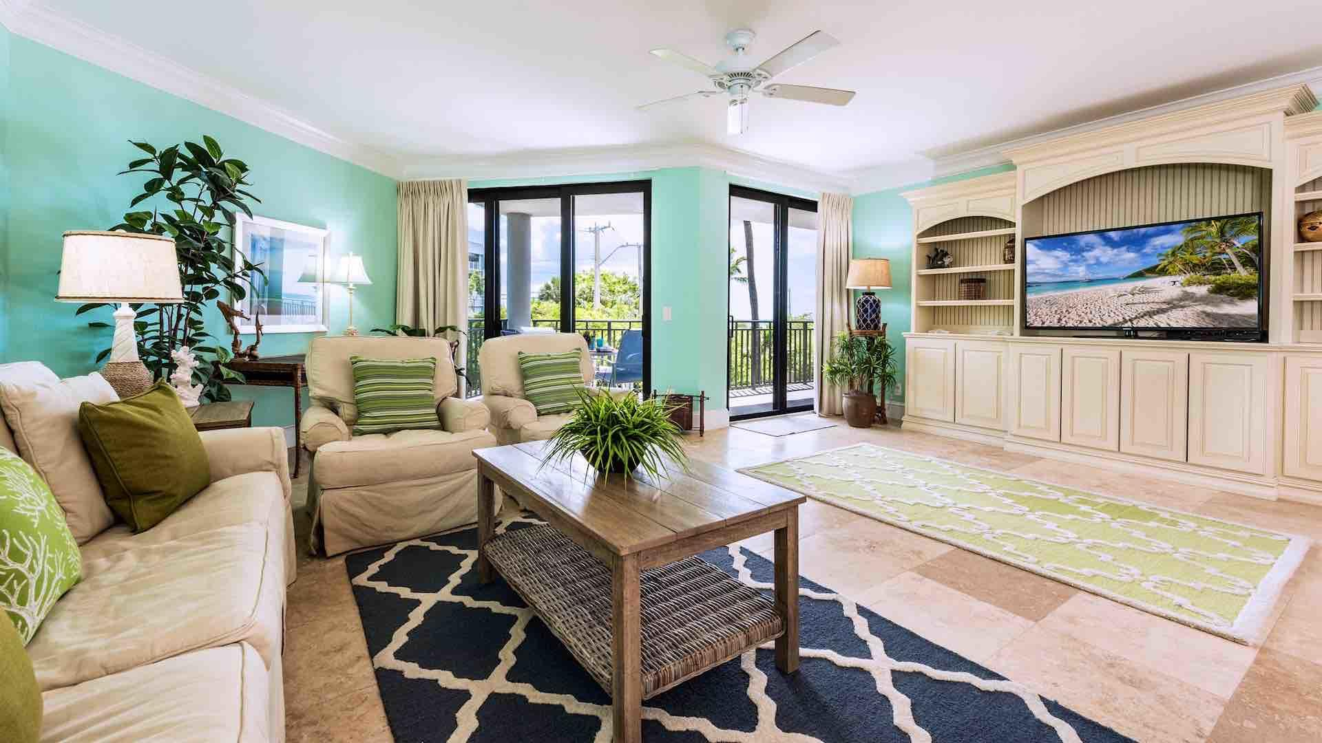 The living room has a large flat screen TV and plenty of comfortable seating options...
