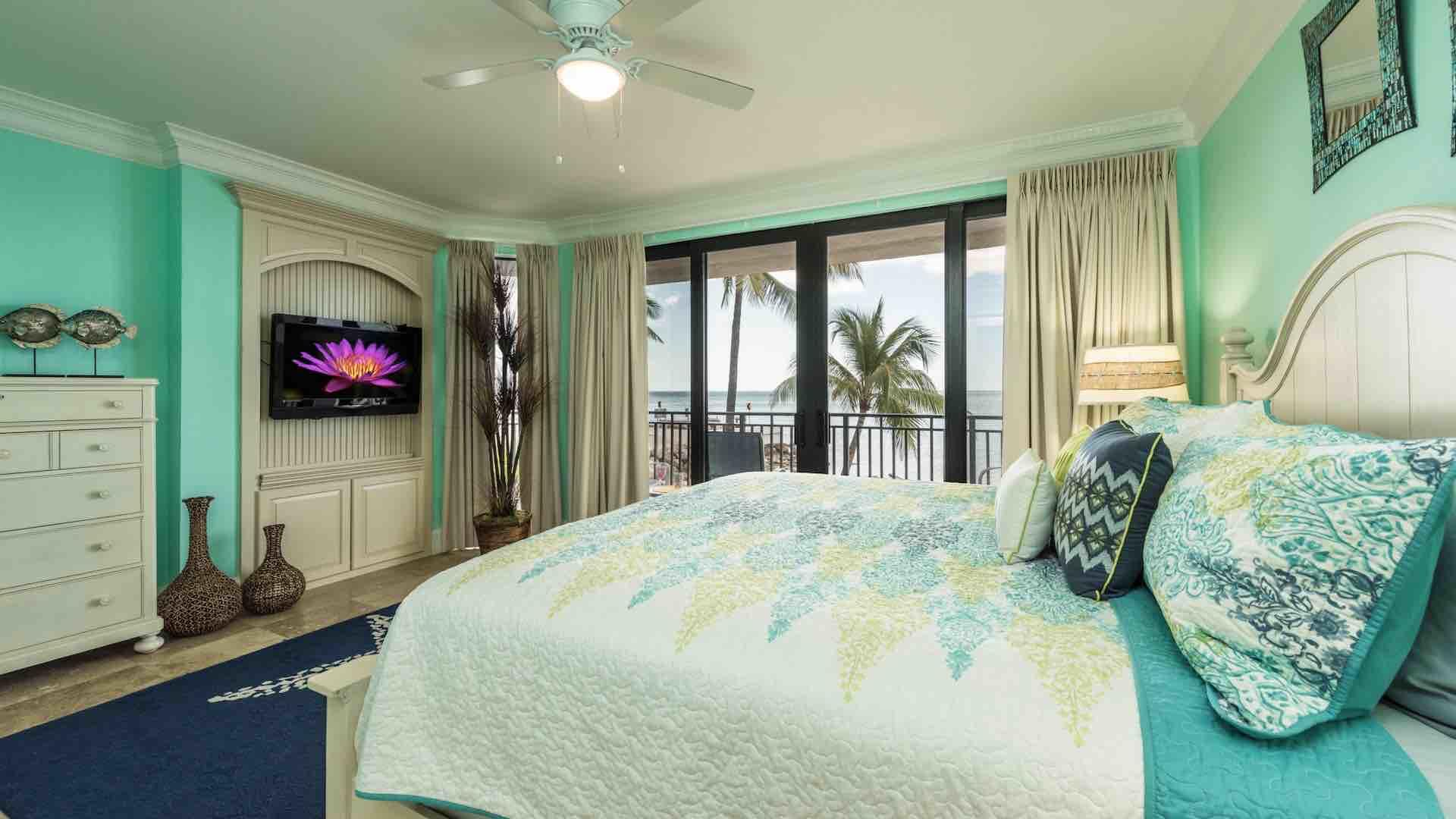 The master bedroom is located at the end of the hall, with a King bed and flat screen TV...