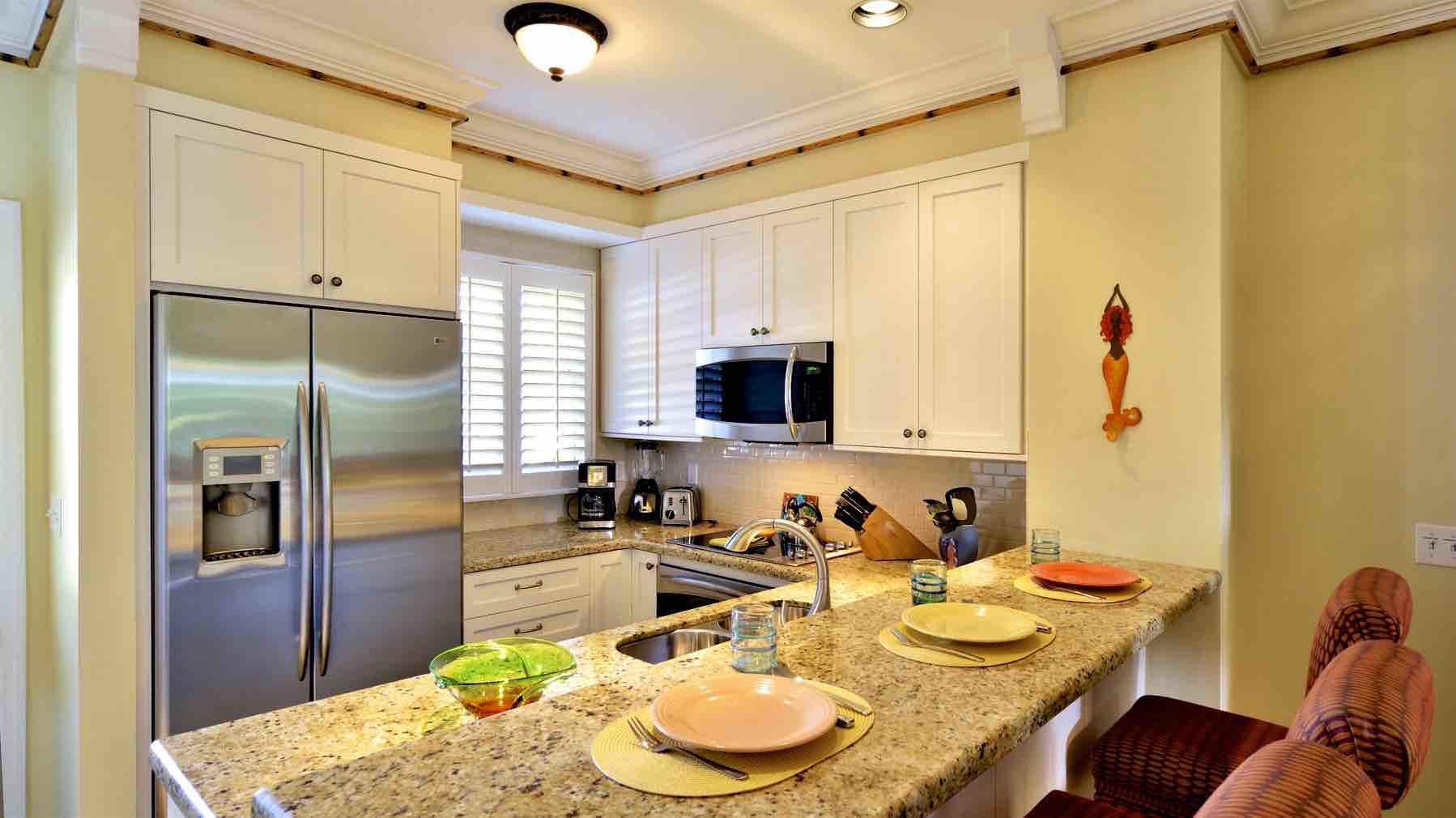 The kitchen has top of the line appliances. the bar will accommodate 3 persons...