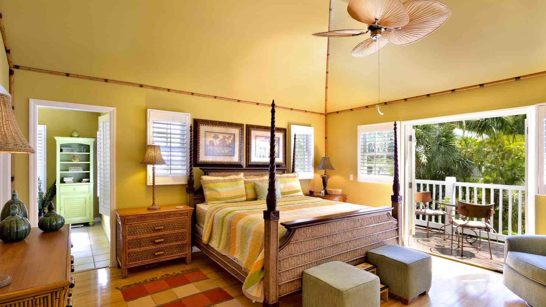 The master bedroom suite has its own balcony, vaulted ceiling and overhead fan...