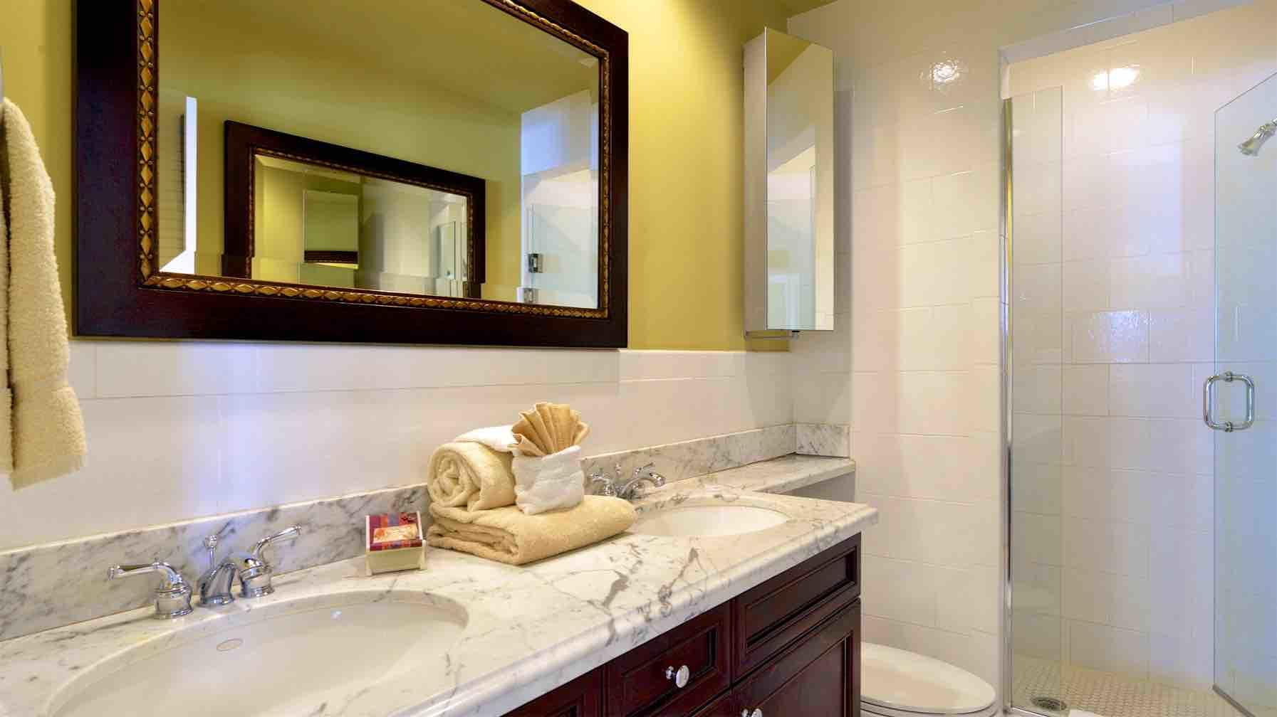 The master bedroom suite inlcudes private bathroom, with twin vanities & shower...