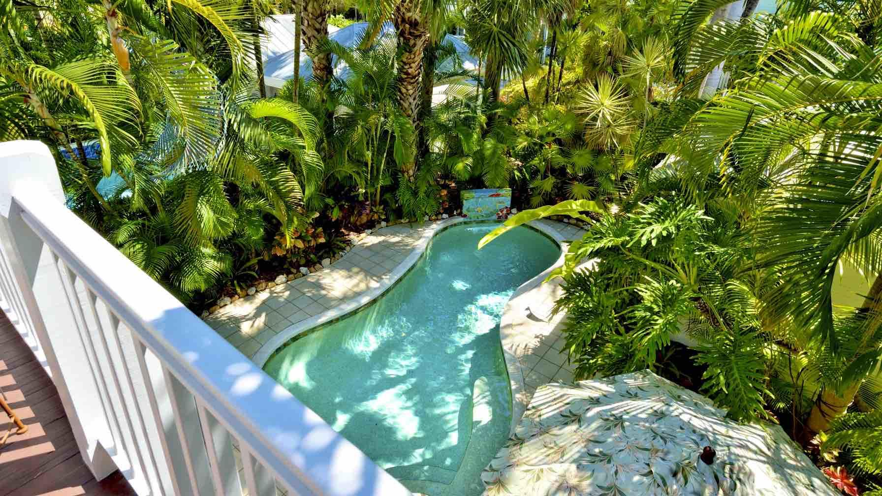 The view from the master bedroom balcony, looking down on the private pool area...