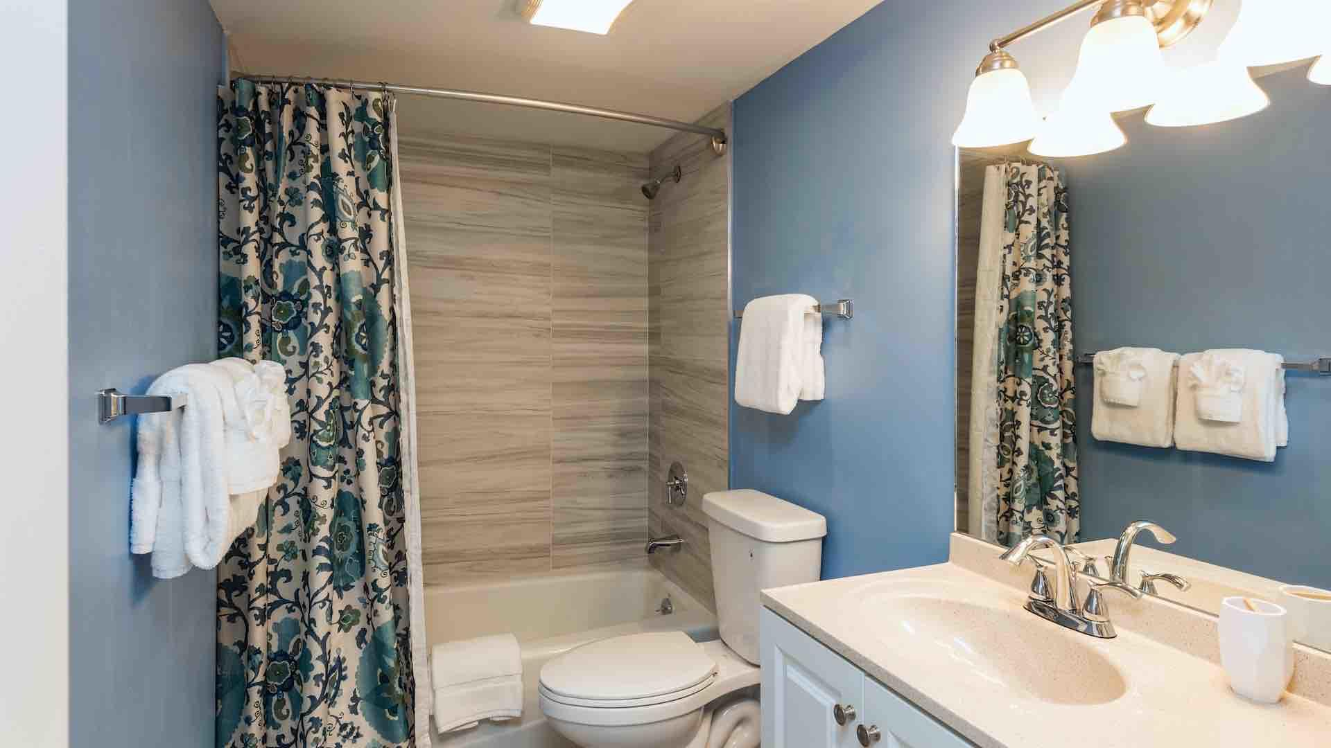The second bathroom has a shower and tub combo...