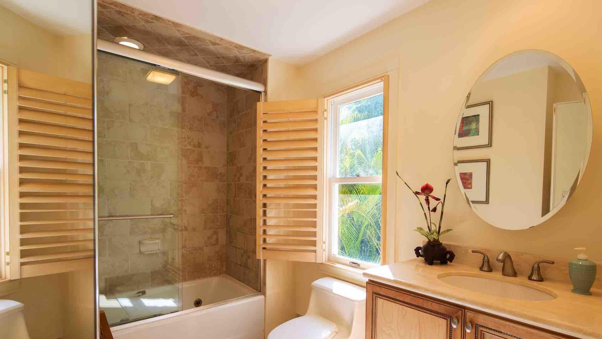 The master bathroom has a shower and tub combo...