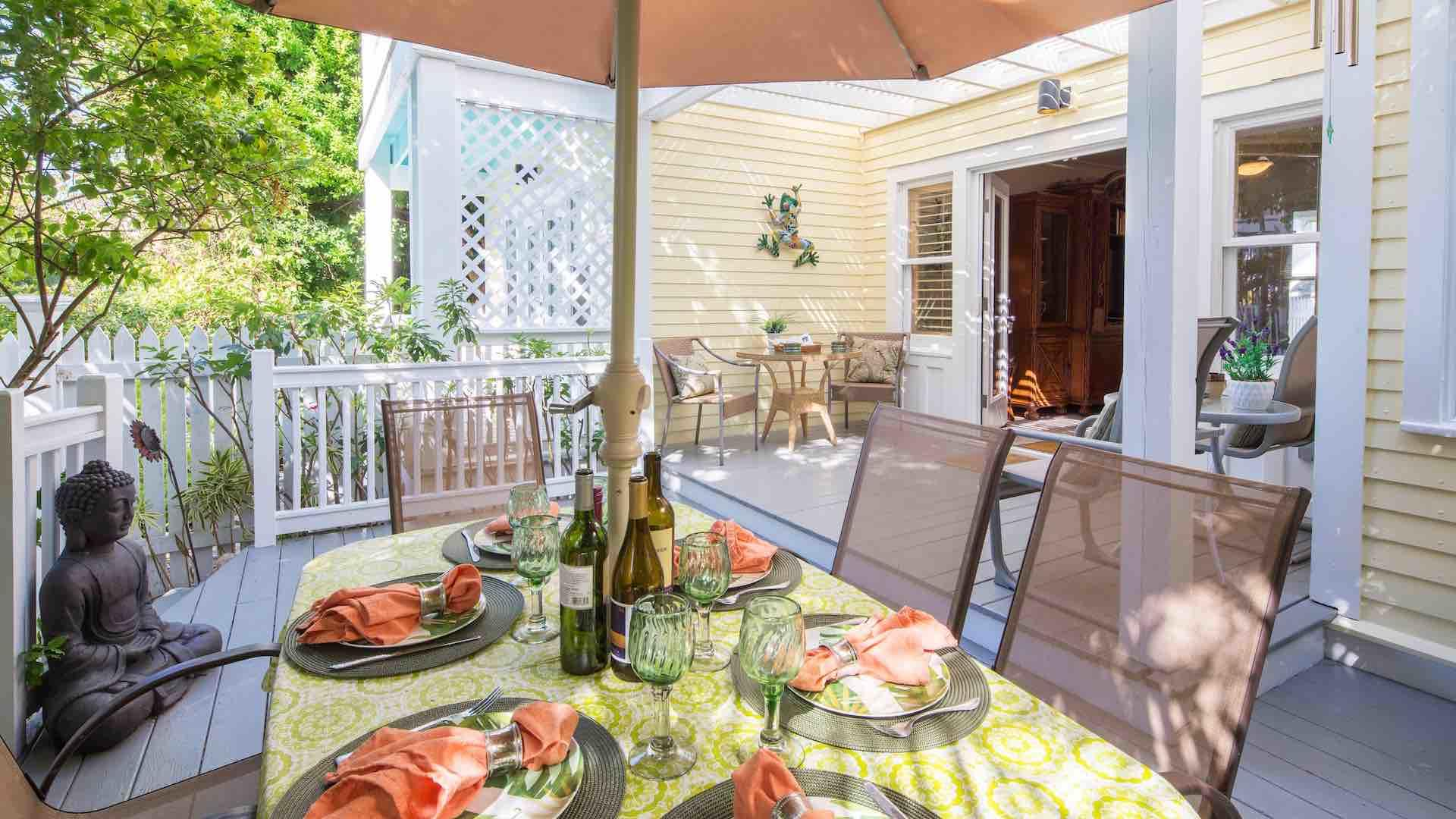 The outdoor dining area is the perfect place to enjoy a meal or have a BBQ...