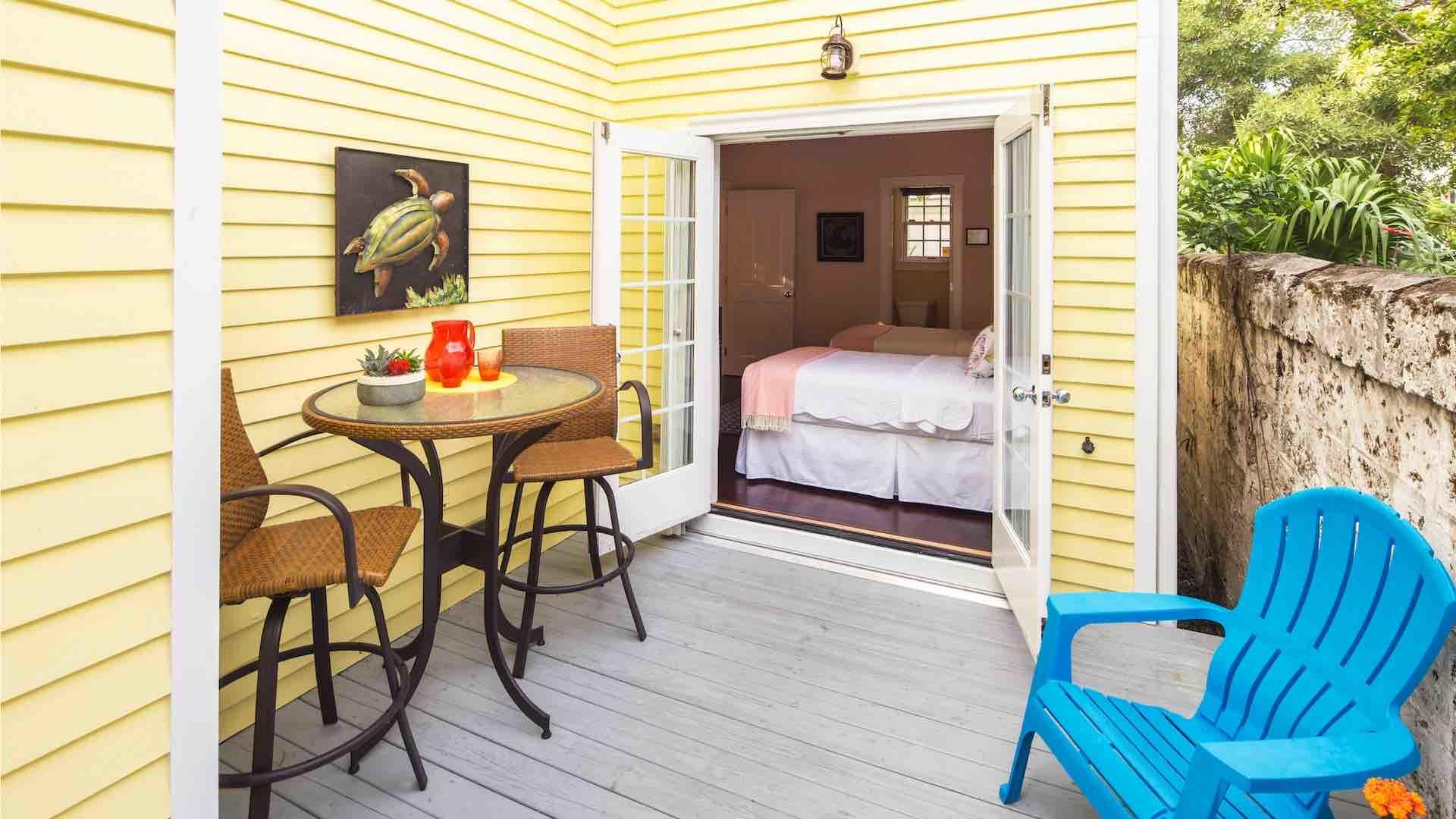 The first floor bedroom has French doors that open up to the back porch...