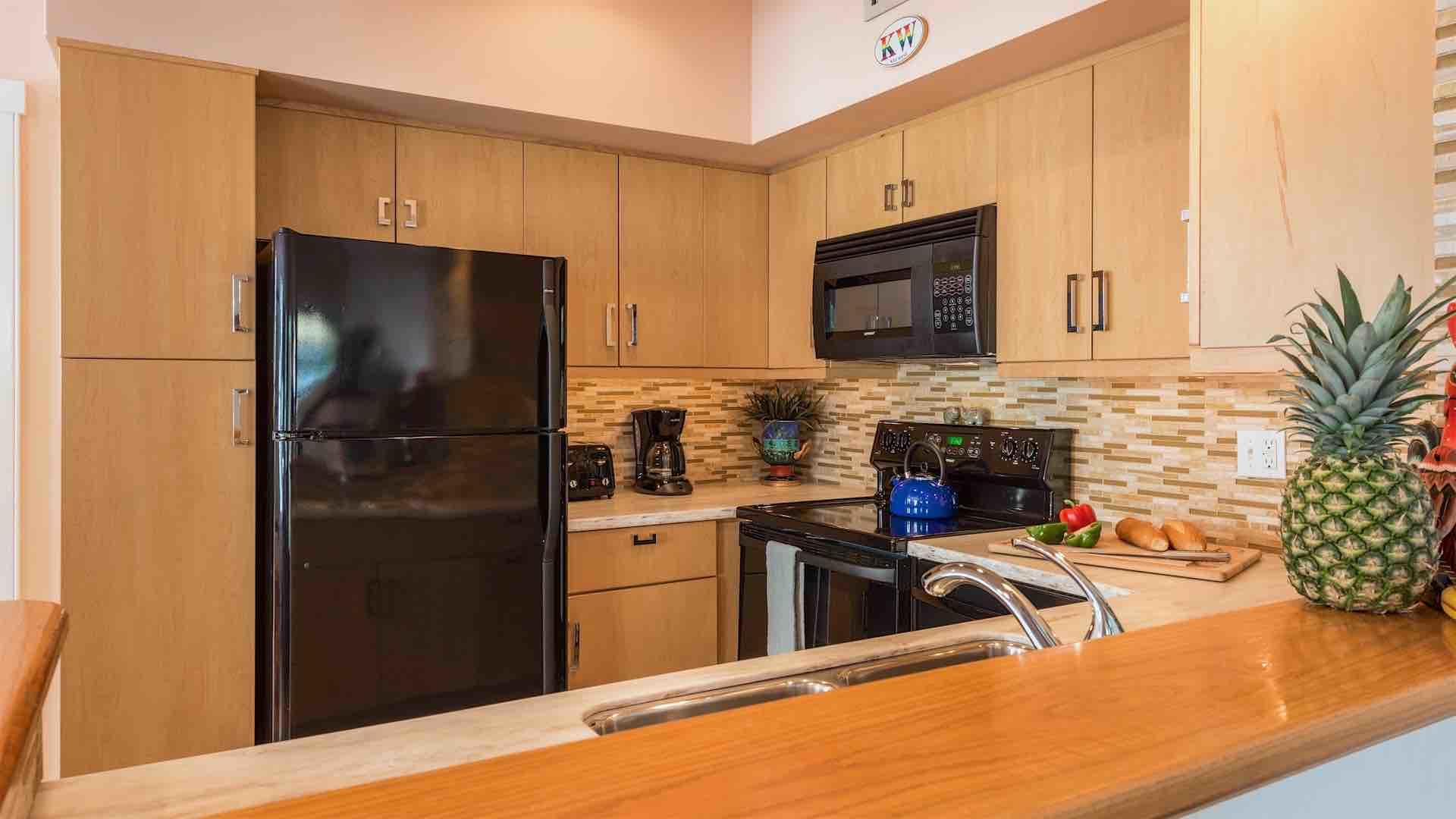 The open kitchen is fully equipped with all the high-end tools and appliances you'll need to whip up a meal at home...