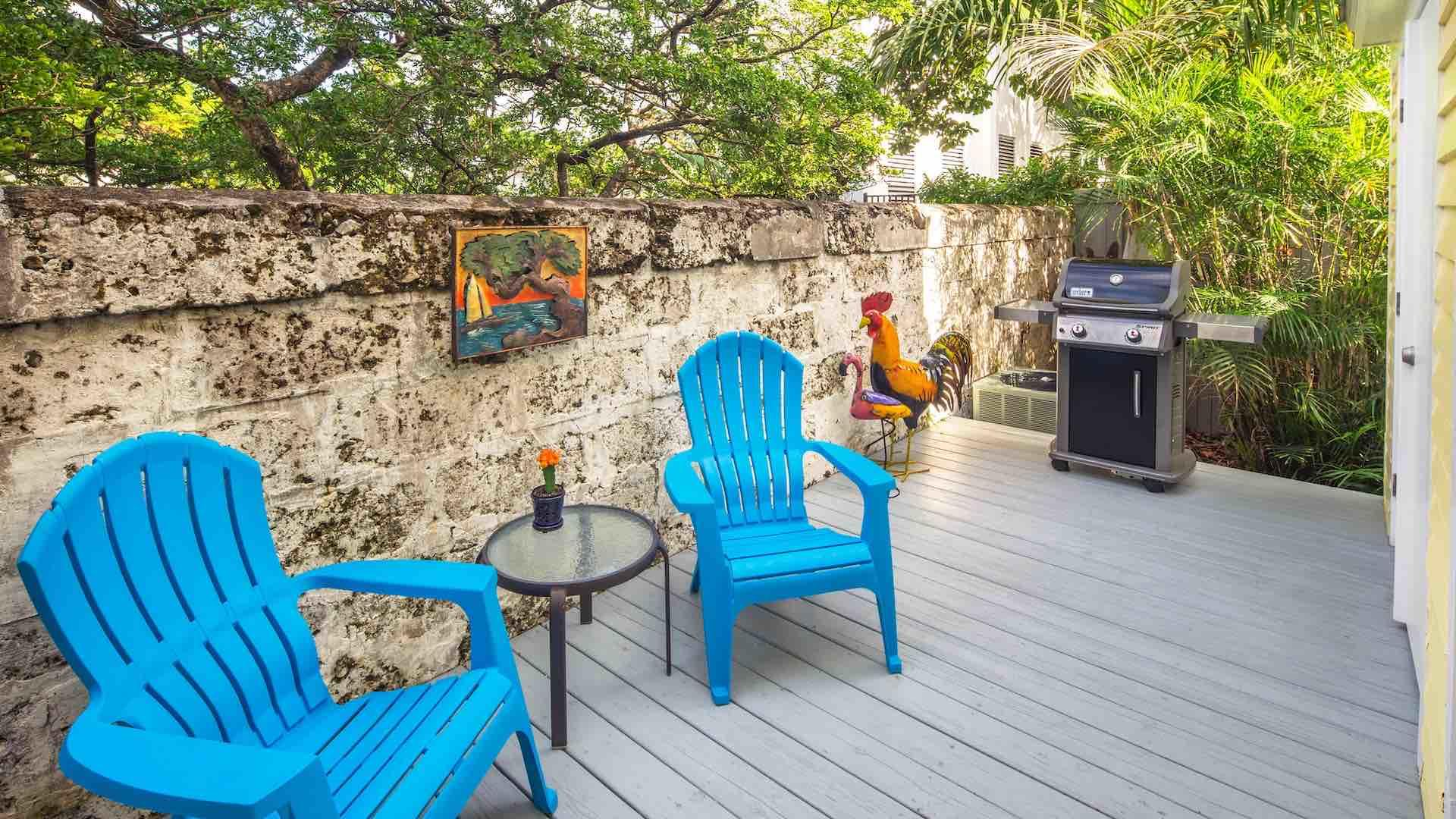 The back porch is equipped with a propane grill and outdoor seating...