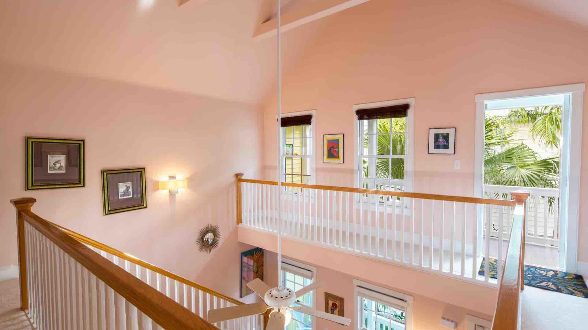 Take the stairs to the second floor, where you'll find the master bedroom and front balcony...