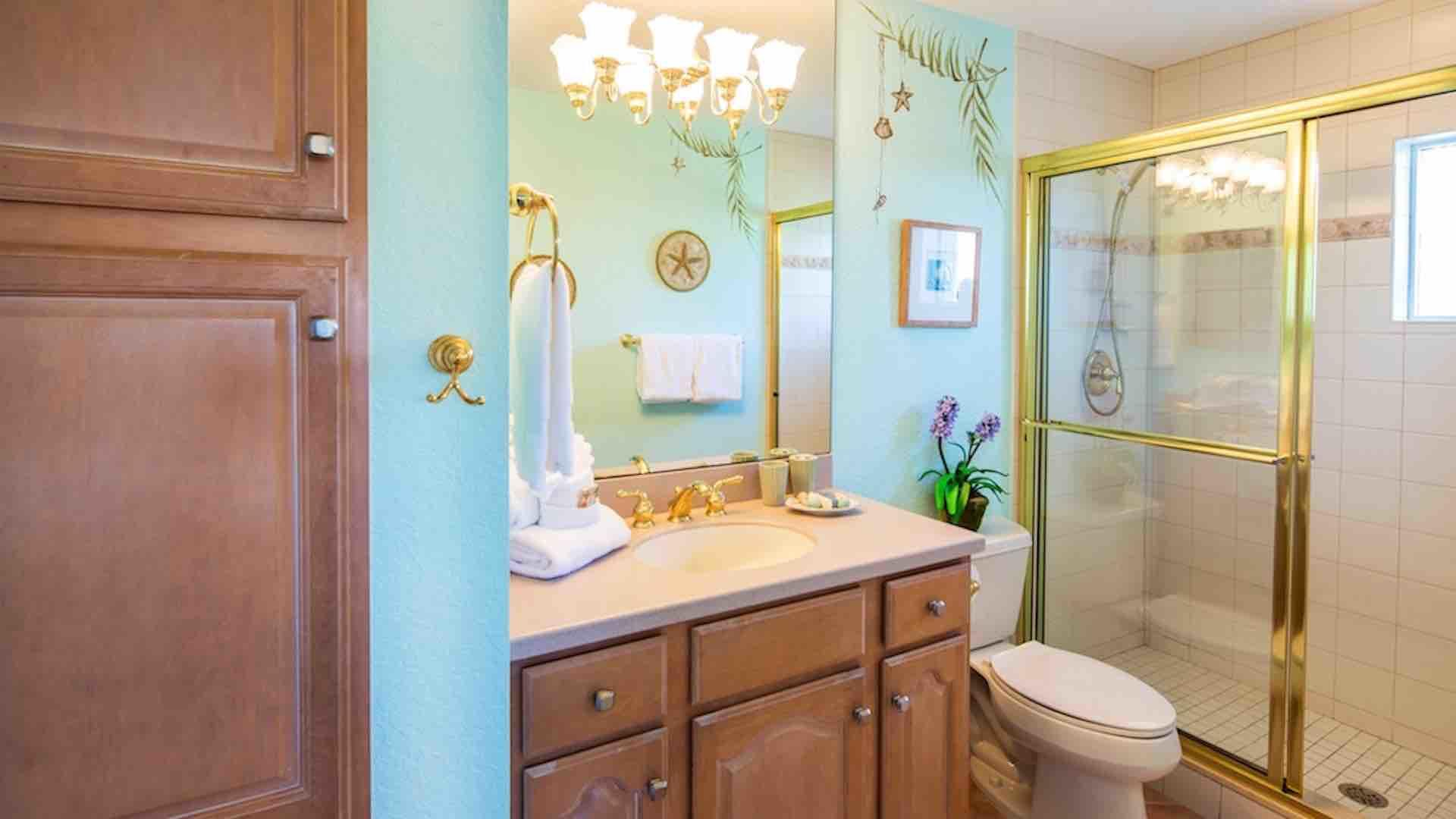 The second bathroom is located between the second and third bedrooms, with a walk-in shower...