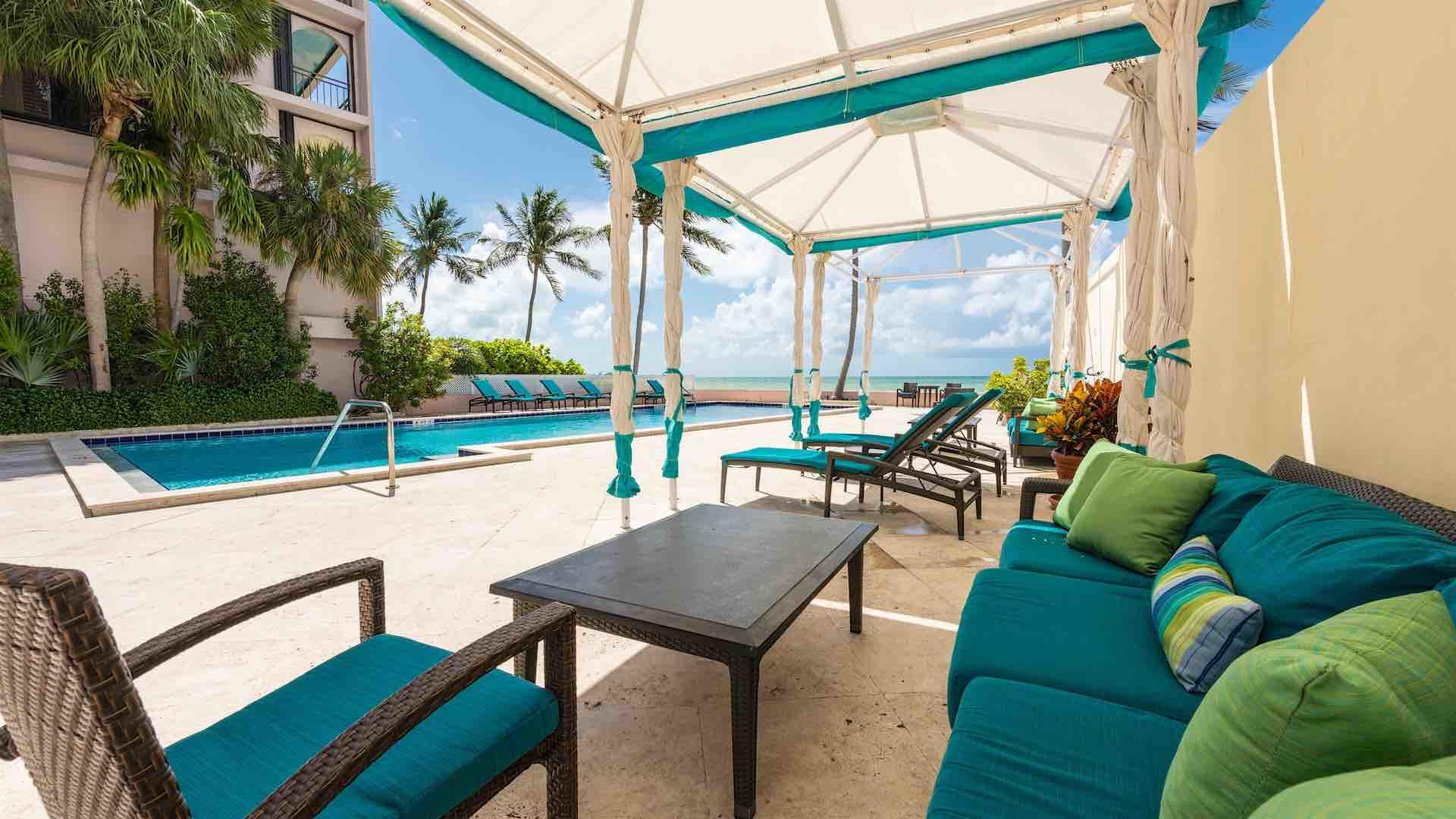 Escape the sun under the cabanas that have comfortable lounging options...