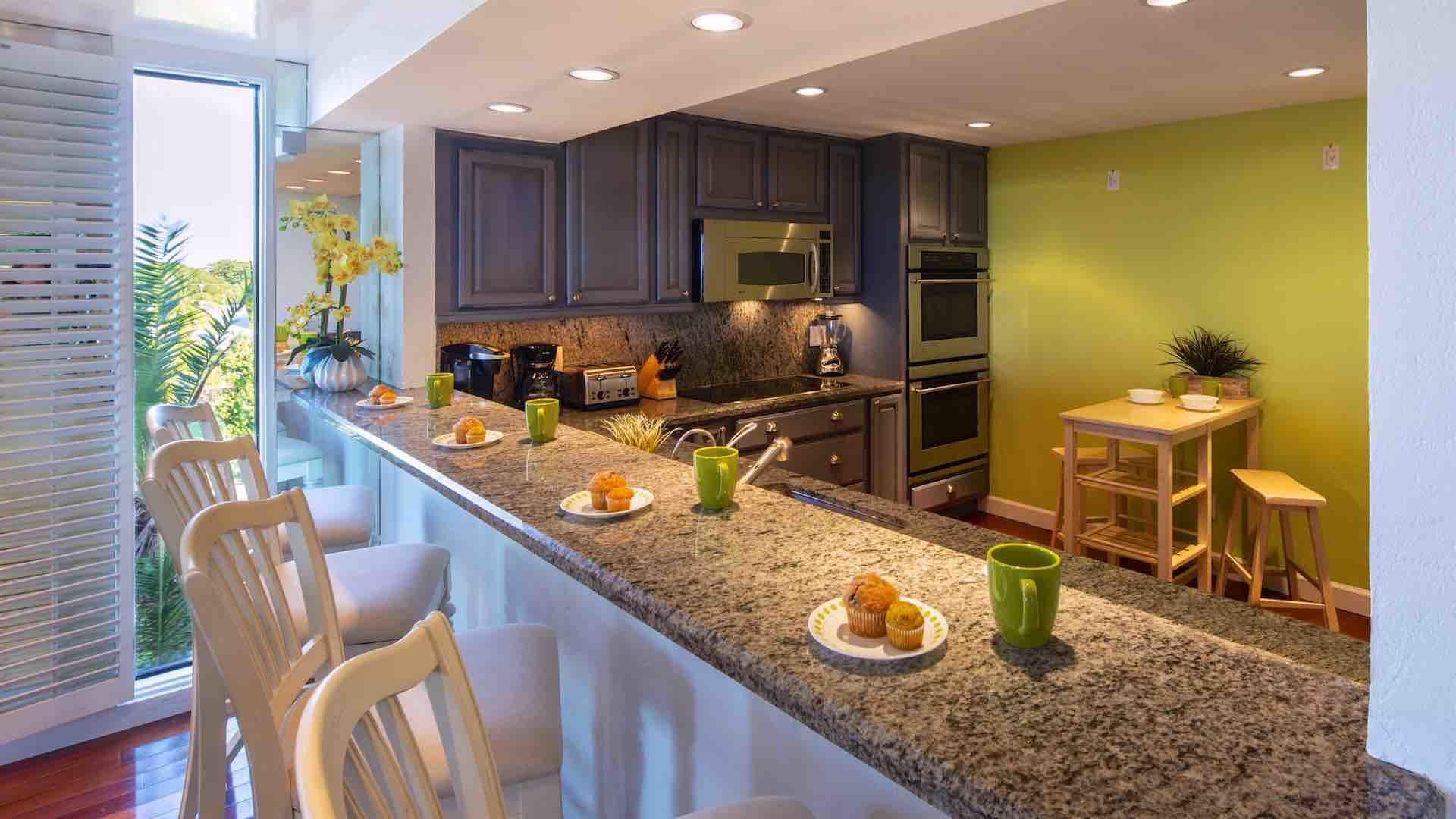 The kitchen is fully equipped with stainless steel appliances...
