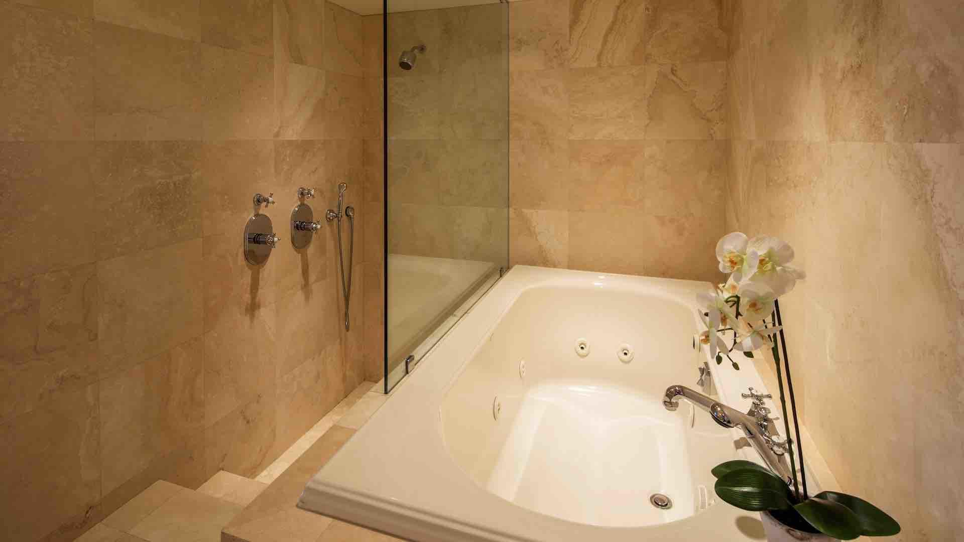 There is a large jacuzzi tub and walk-in shower located in the master bathroom..