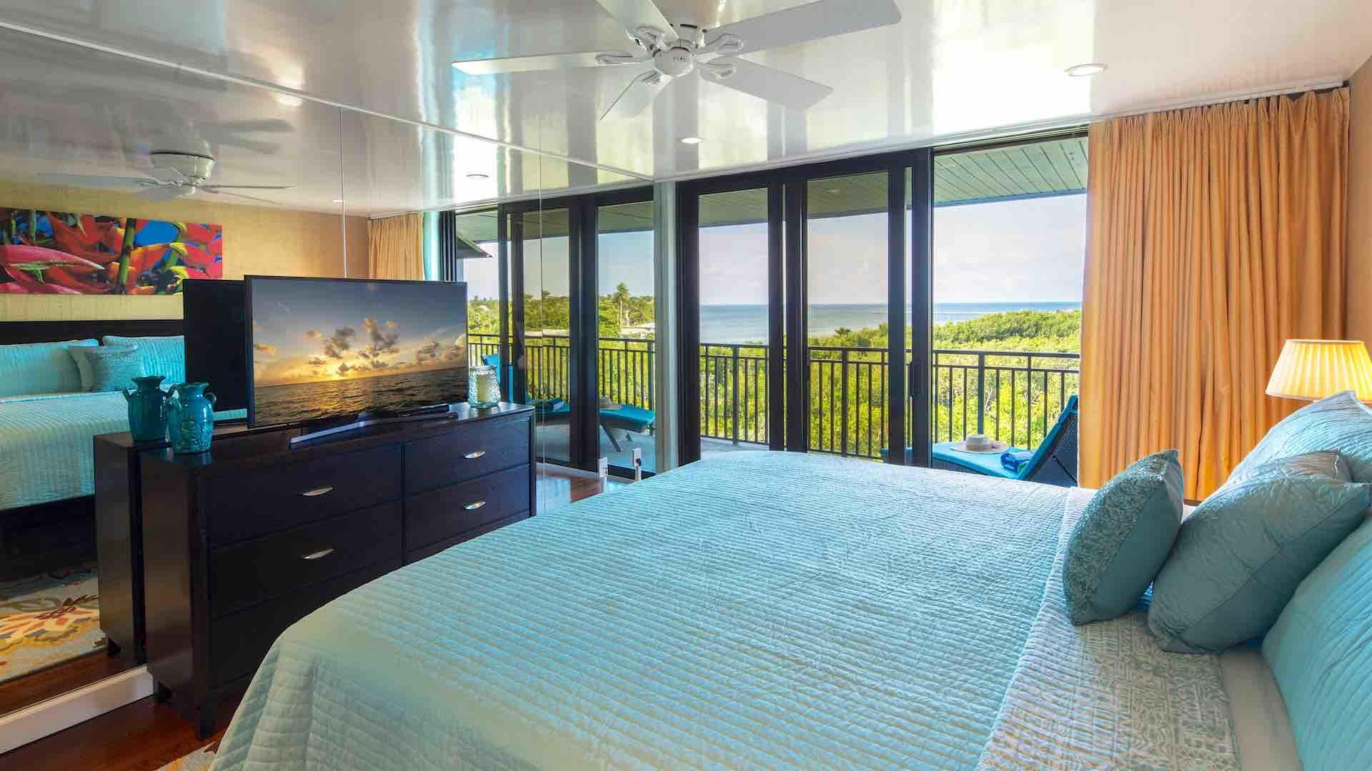 The master bedroom has a King bed and a flat screen TV...