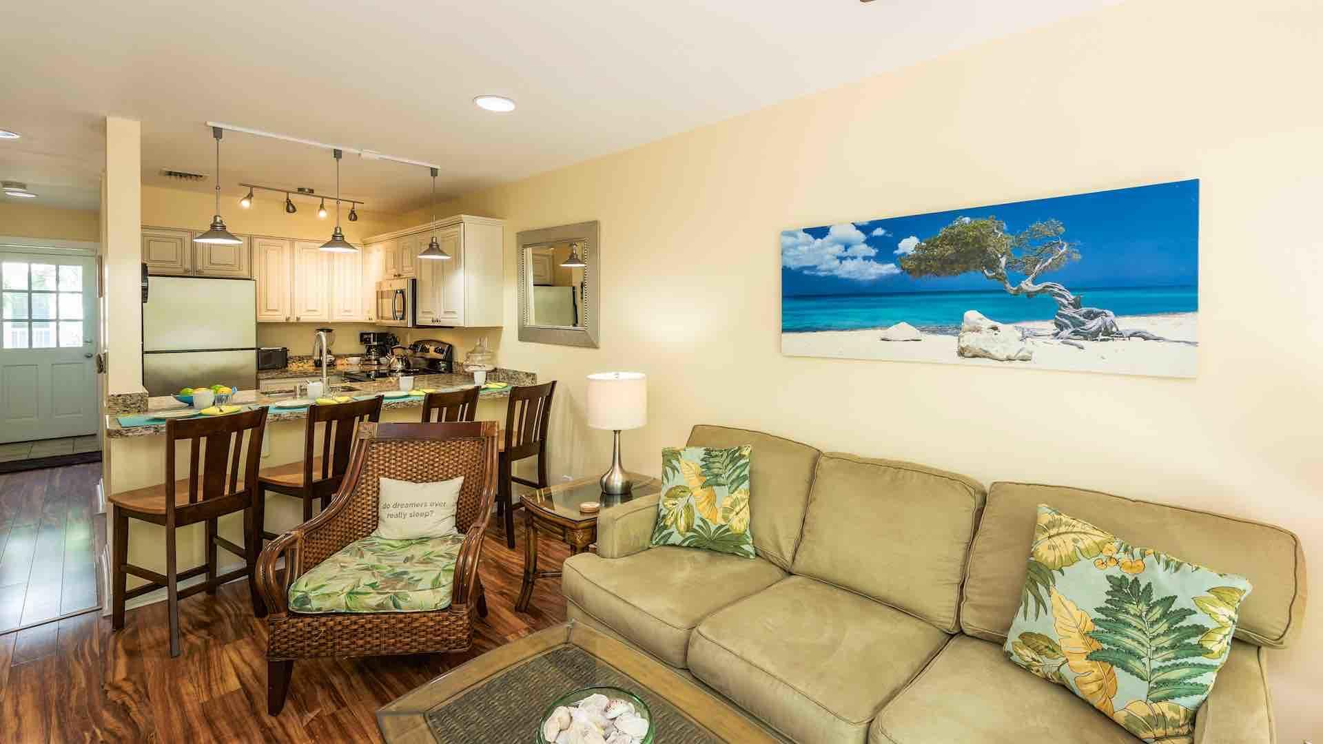 The living room and kitchen are open, making the condo ideal for entertaining...