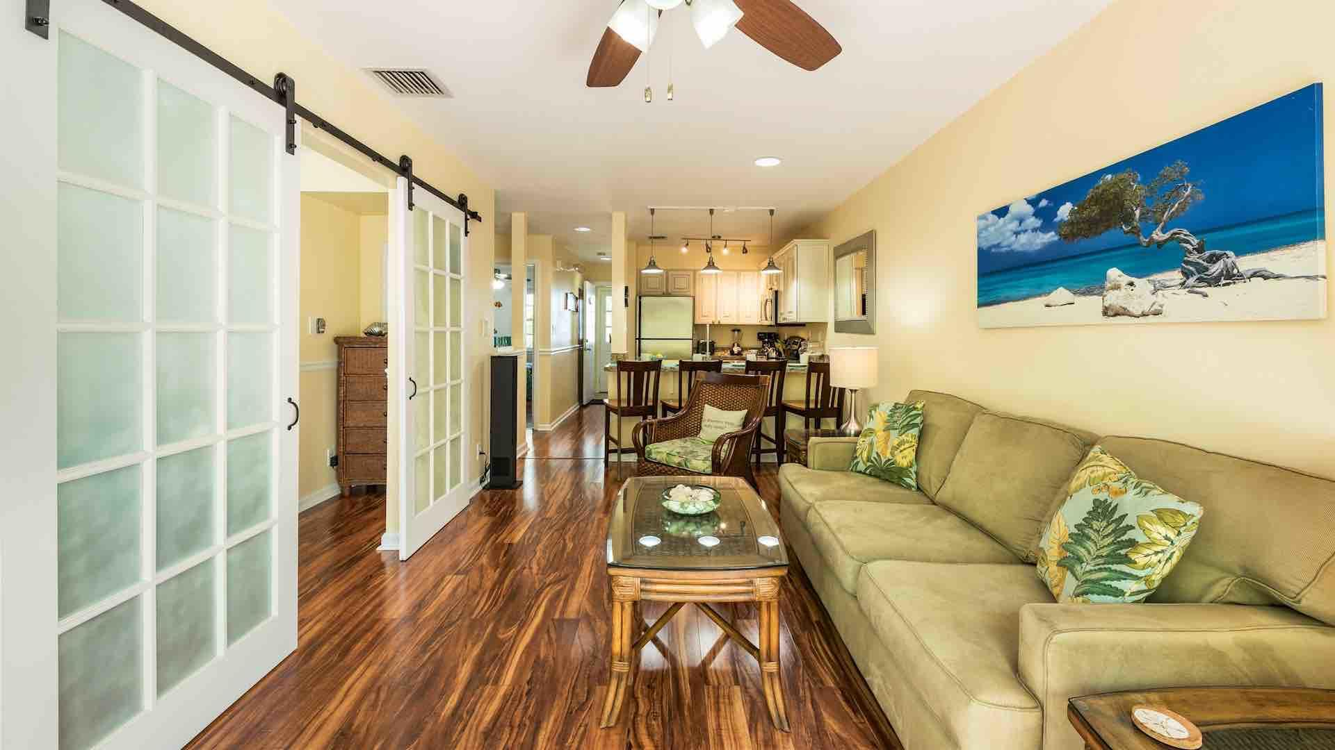 The living room has a large flat screen TV and comfortable seating options...