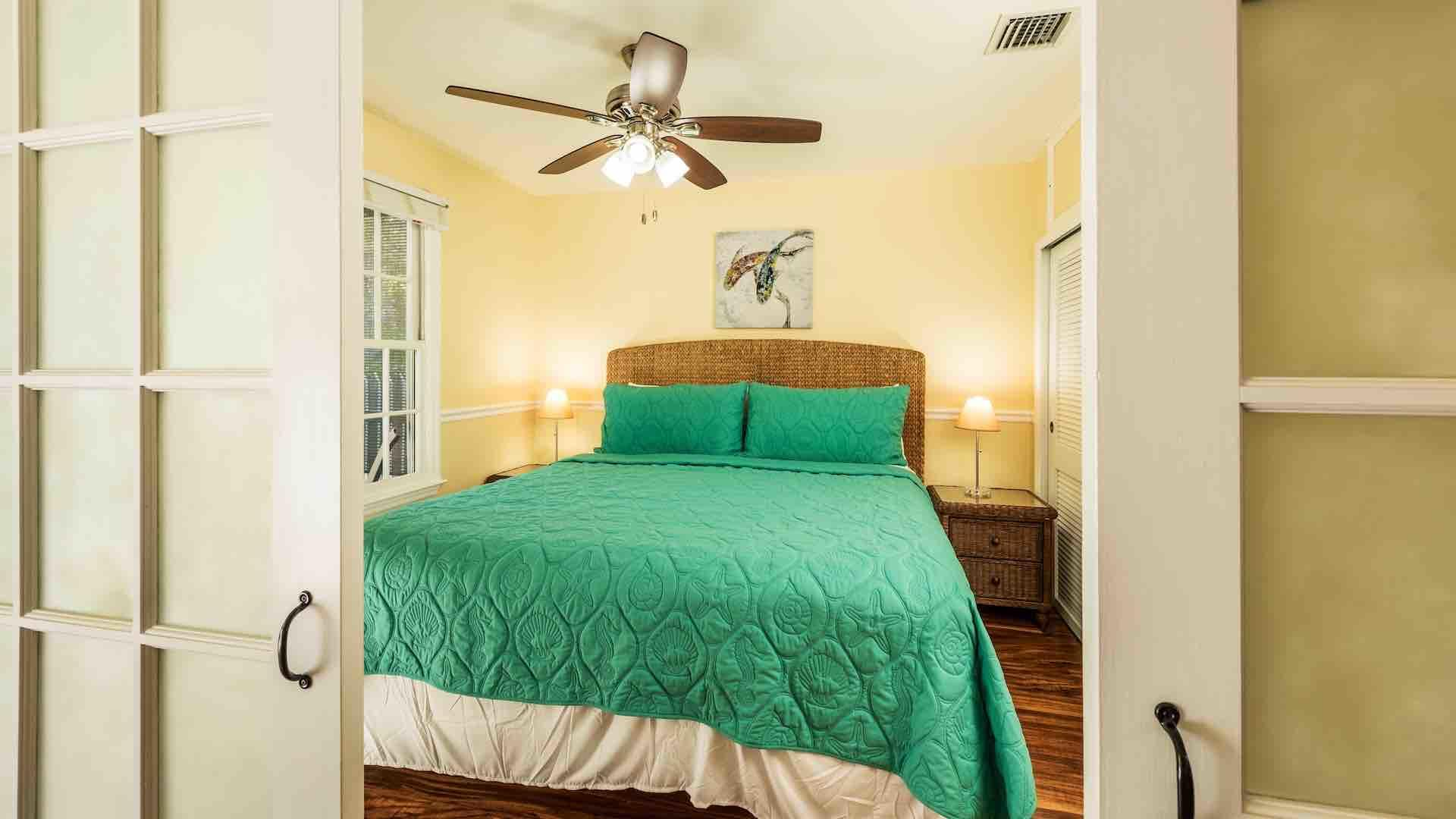 The master bedroom has a King bed and overhead fan...