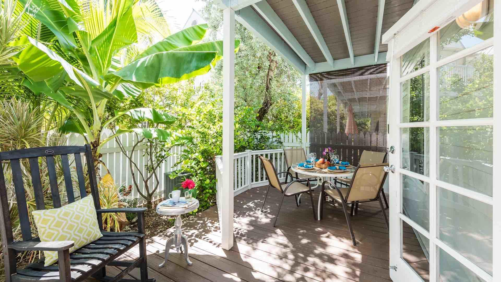 The back patio and deck are completely private and surrounded by lush foliage...