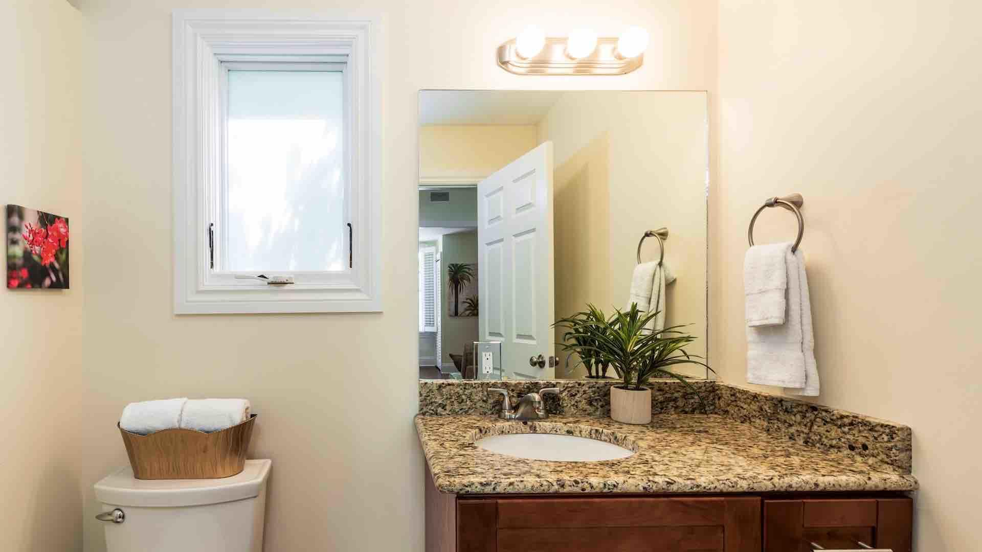 The second downstairs bathroom is located just off the living room and connects to the second bedroom...