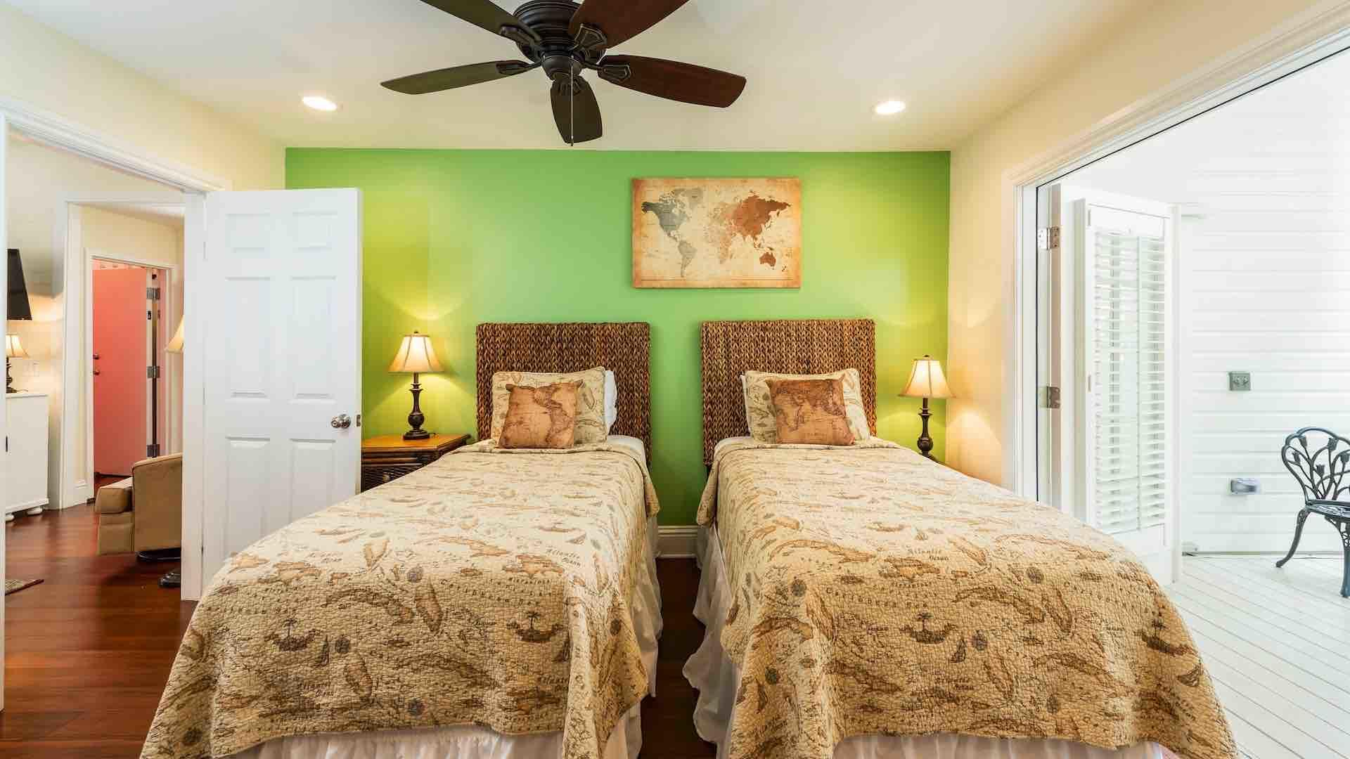 The second downstairs bedroom has two twin beds that can convert to a King bed upon request...